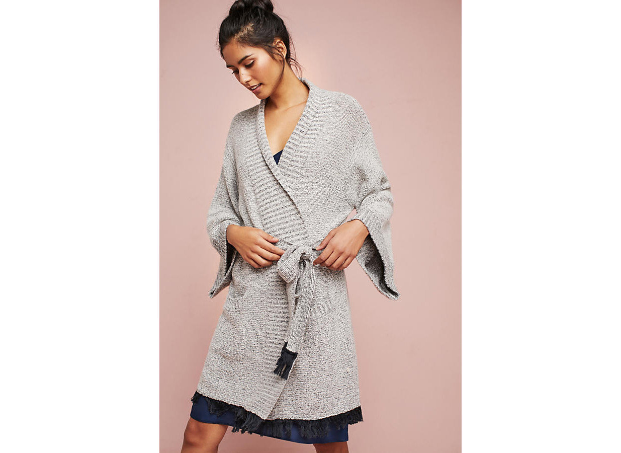 Style + Design Travel Shop person clothing indoor standing outerwear sleeve fashion model day dress coat neck posing