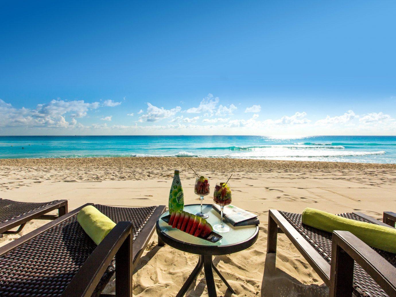 Hotels sky water outdoor Beach shore Sea leisure body of water Ocean Nature vacation horizon Coast sand caribbean bay wave