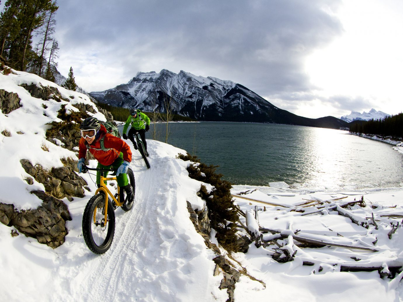 Offbeat outdoor sky snow mountainous landforms Winter mountain vehicle mountain range weather season bicycle motorcycle mountain bike alps extreme sport freeride winter sport mountain biking sports equipment