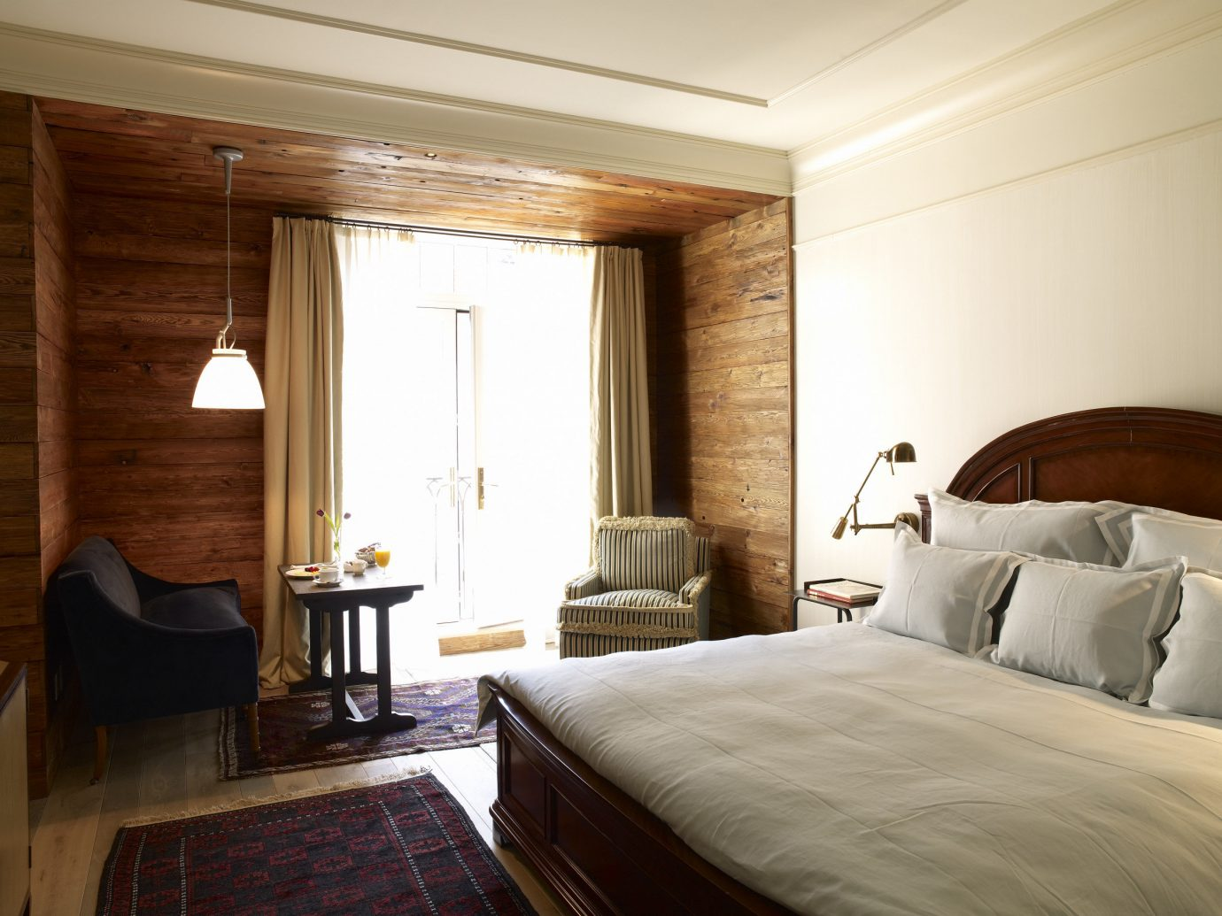 Hotels Jetsetter Guides Travel Tips Trip Ideas indoor bed wall room floor hotel ceiling Suite Bedroom interior design real estate window wood bed frame interior designer wood flooring comfort