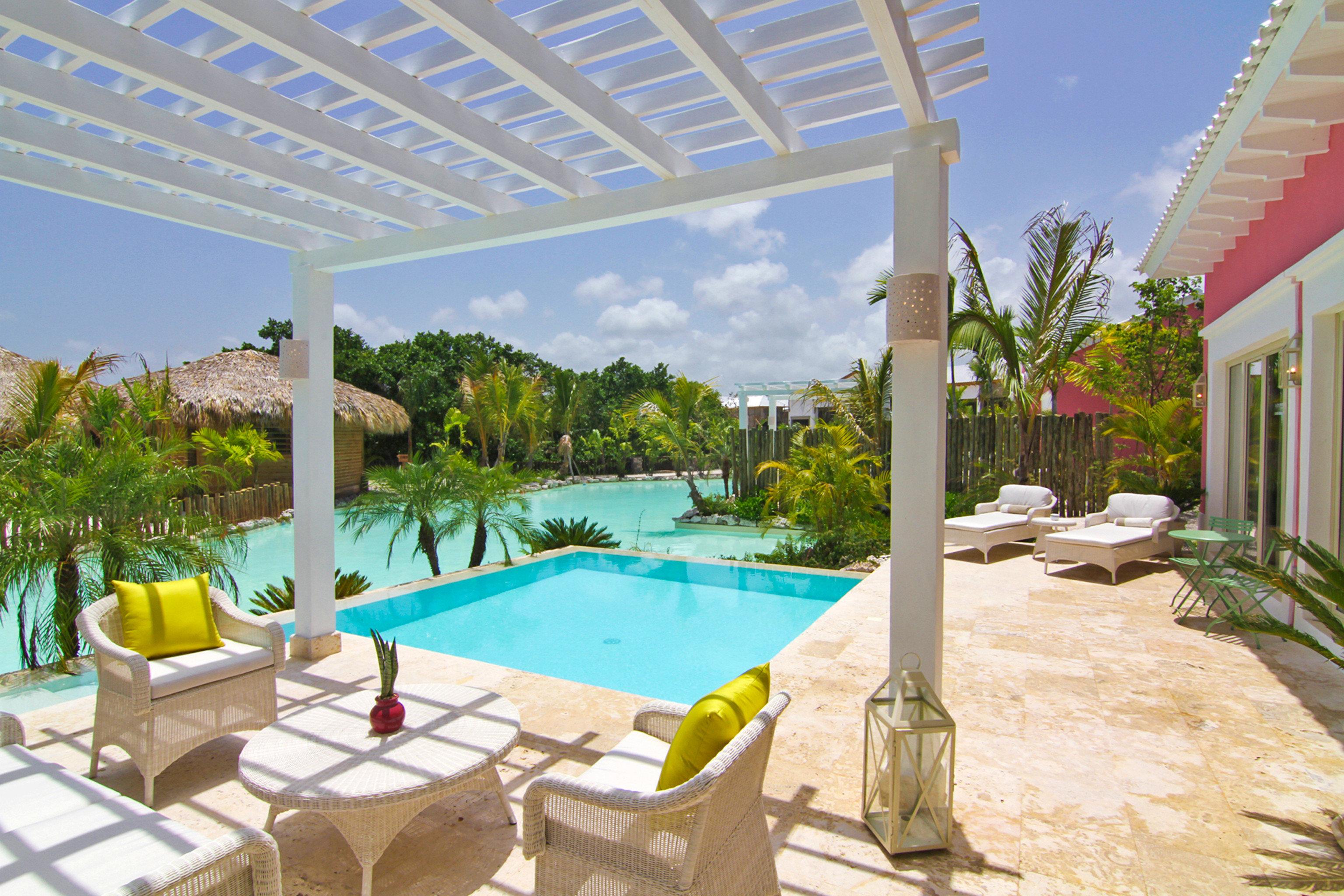 Hotels outdoor property swimming pool Resort Villa estate condominium vacation real estate Pool backyard hacienda home outdoor structure eco hotel apartment furniture several