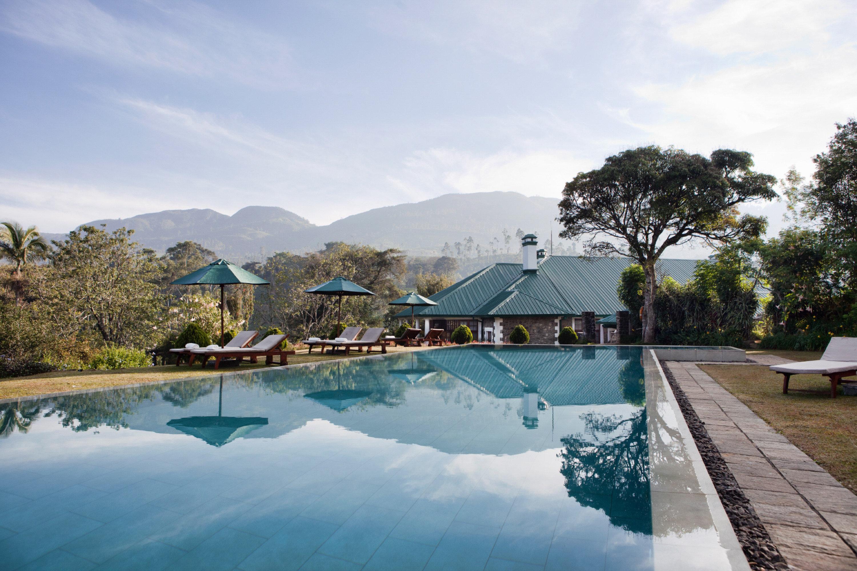 All-Inclusive Resorts Food + Drink Hotels Romantic Hotels outdoor sky swimming pool property estate vacation Resort Nature Lake bay Villa Sea shore