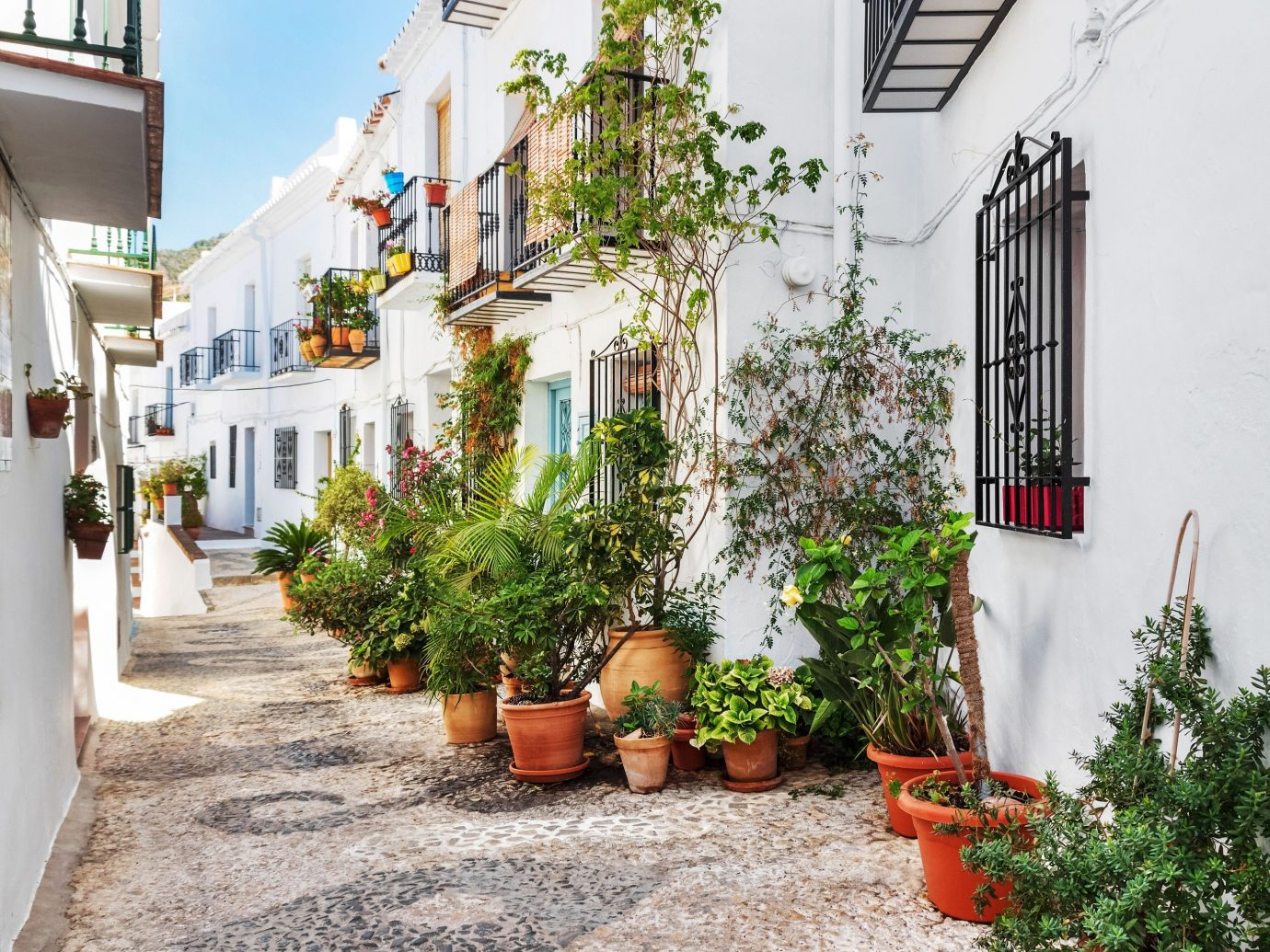 Trip Ideas outdoor house property way neighbourhood Town home Courtyard residential area street plant estate flower Balcony facade cottage alley sidewalk Garden yard Village apartment stone
