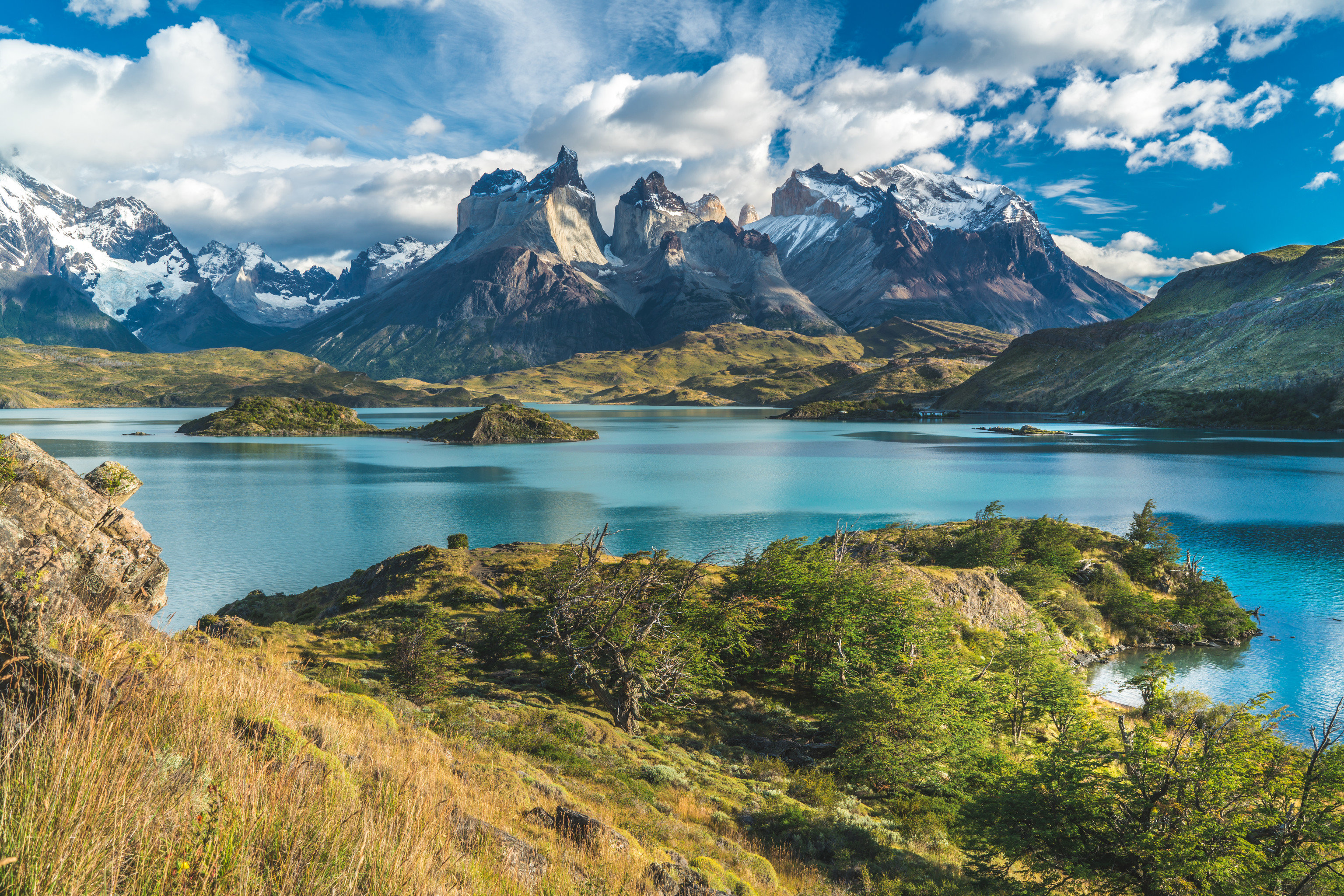 Outdoors + Adventure mountain outdoor sky Nature grass water mountainous landforms wilderness highland reflection mount scenery Lake canyon fell mountain range fjord cloud national park tarn bank landscape hillside tree River alps loch reservoir hill elevation glacial landform crater lake tundra overlooking surrounded lush