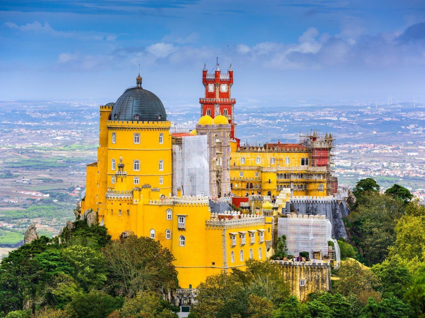 Trip Ideas tree outdoor sky yellow tower landmark Coast tourism castle Sea