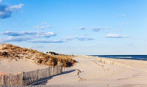 sky outdoor habitat natural environment landform shore Nature Beach sand dune Coast aeolian landform Sea day