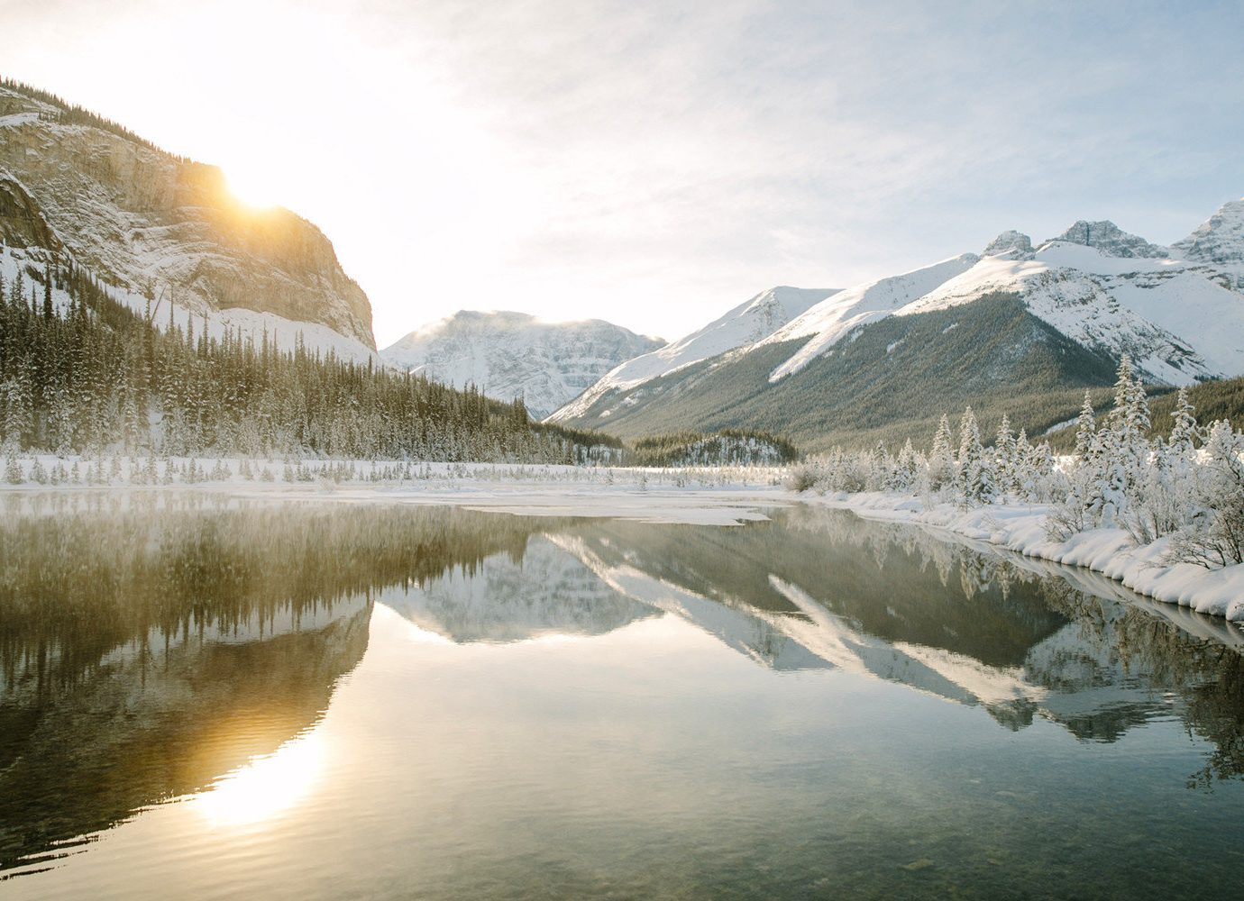 Alberta Canada Road Trips Trip Ideas outdoor Nature sky reflection mountain water Winter snow mountainous landforms wilderness Lake freezing mountain range morning bank tree alps mount scenery sunlight landscape River fell reservoir loch fjord water resources glacial landform national park ice cloud computer wallpaper calm lake district tarn