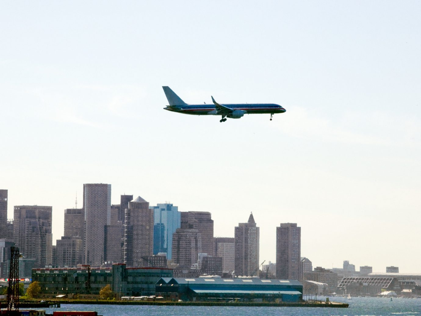 Flights Travel Tips sky outdoor flying aircraft water plane transport airline airplane City vehicle aviation atmosphere of earth air airliner flight infrastructure low skyline land landing Sea