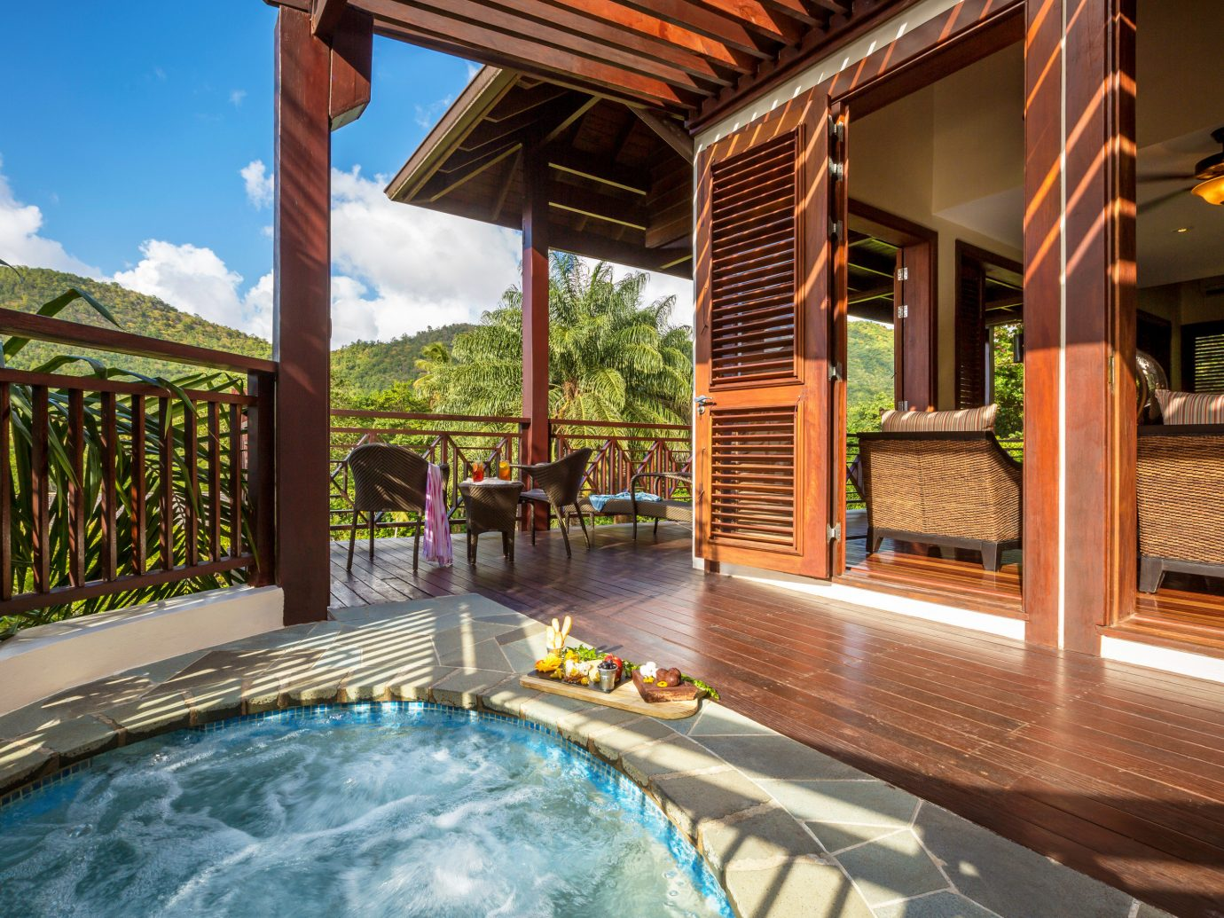 Hotels Luxury Travel outdoor building property Resort swimming pool leisure estate vacation bathtub Villa vessel real estate Pool home backyard eco hotel cottage furniture colonnade