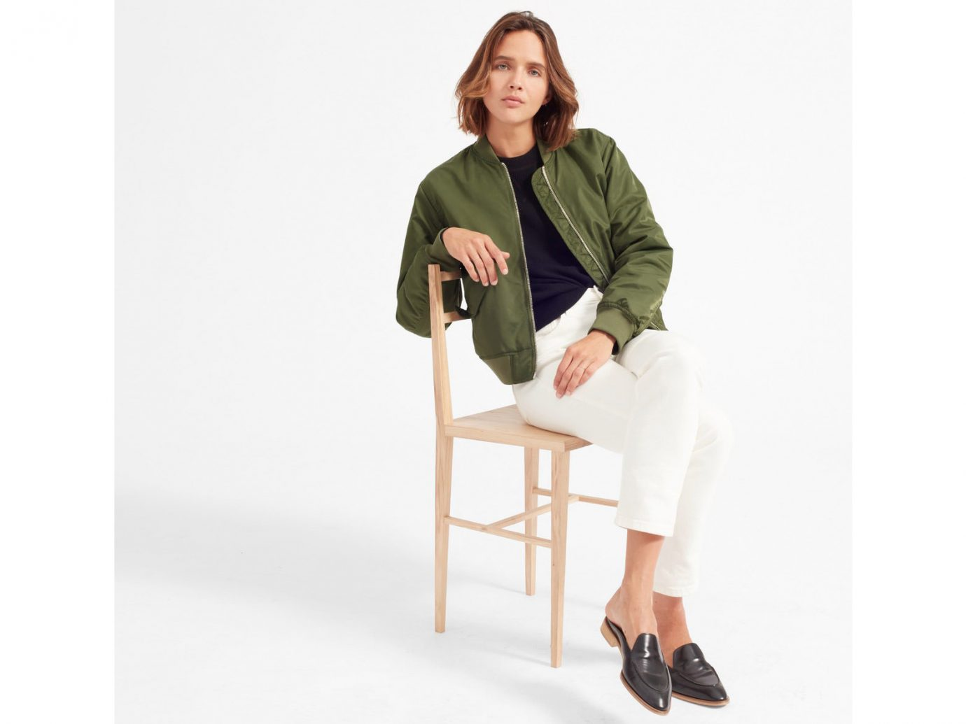Packing Tips Spring Travel Style + Design Travel Shop person sitting standing shoulder furniture outerwear product design jacket sleeve neck coat posing