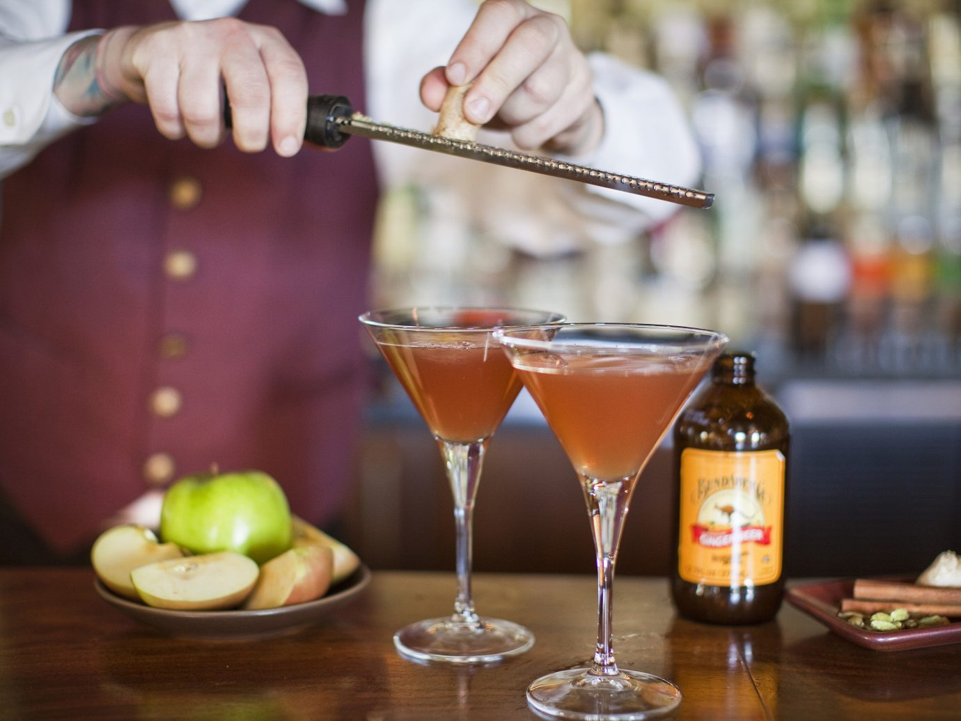 Hotels table person alcoholic beverage Drink cocktail distilled beverage liqueur food