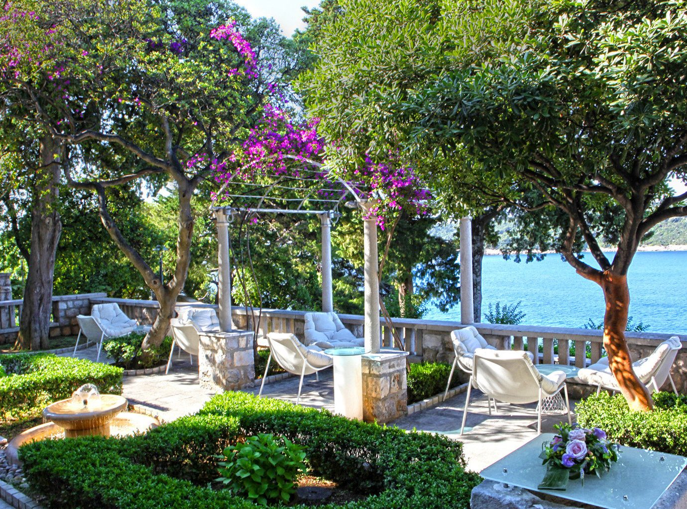 Beachfront Play Scenic views Trip Ideas Wellness tree outdoor property flower estate Resort Garden home real estate backyard yard plant Villa cottage shade