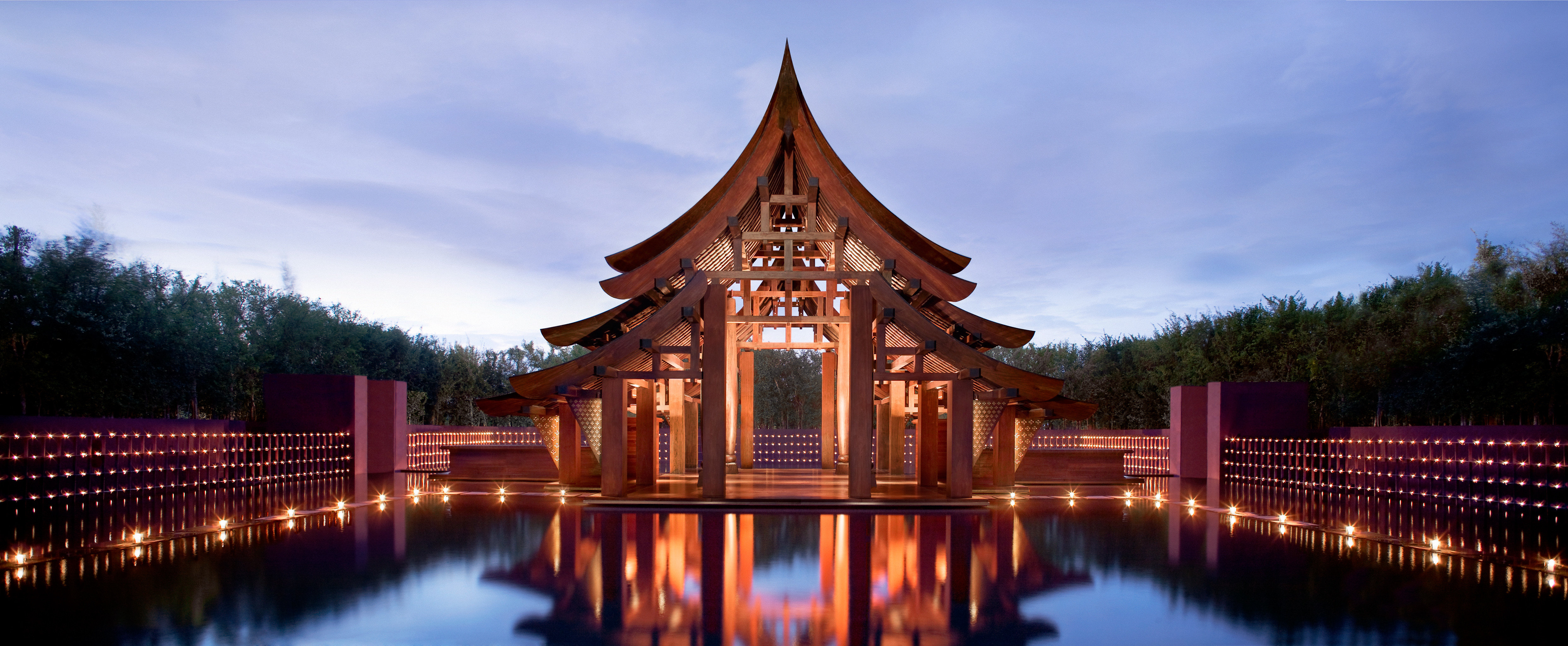 Beachfront Cultural Grounds Honeymoon Influencers + Tastemakers Jungle Nature Pool Romance Romantic Scenic views Travel Shop Trip Ideas Tropical outdoor sky water landmark reflection building night evening place of worship temple shrine