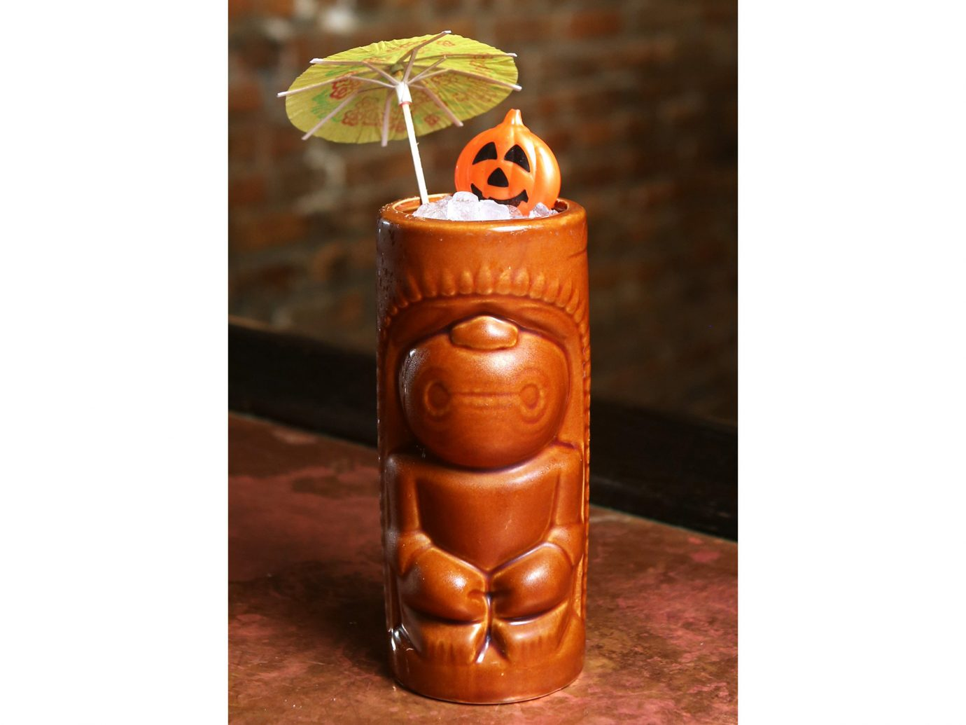Food + Drink man made object candle tiki lighting bottle distilled beverage produce orange colored