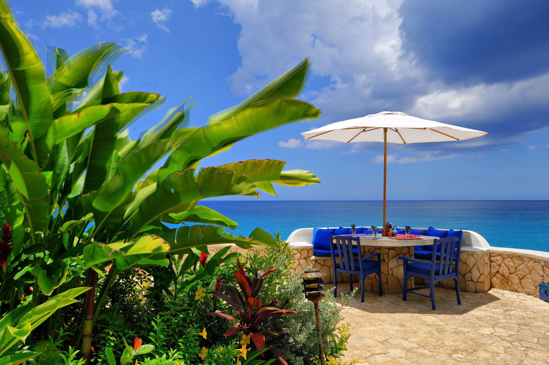 Hotels Luxury Romance Romantic Scenic views Tropical Waterfront sky outdoor Sea Ocean caribbean tropics vacation Beach Coast arecales Island bay day