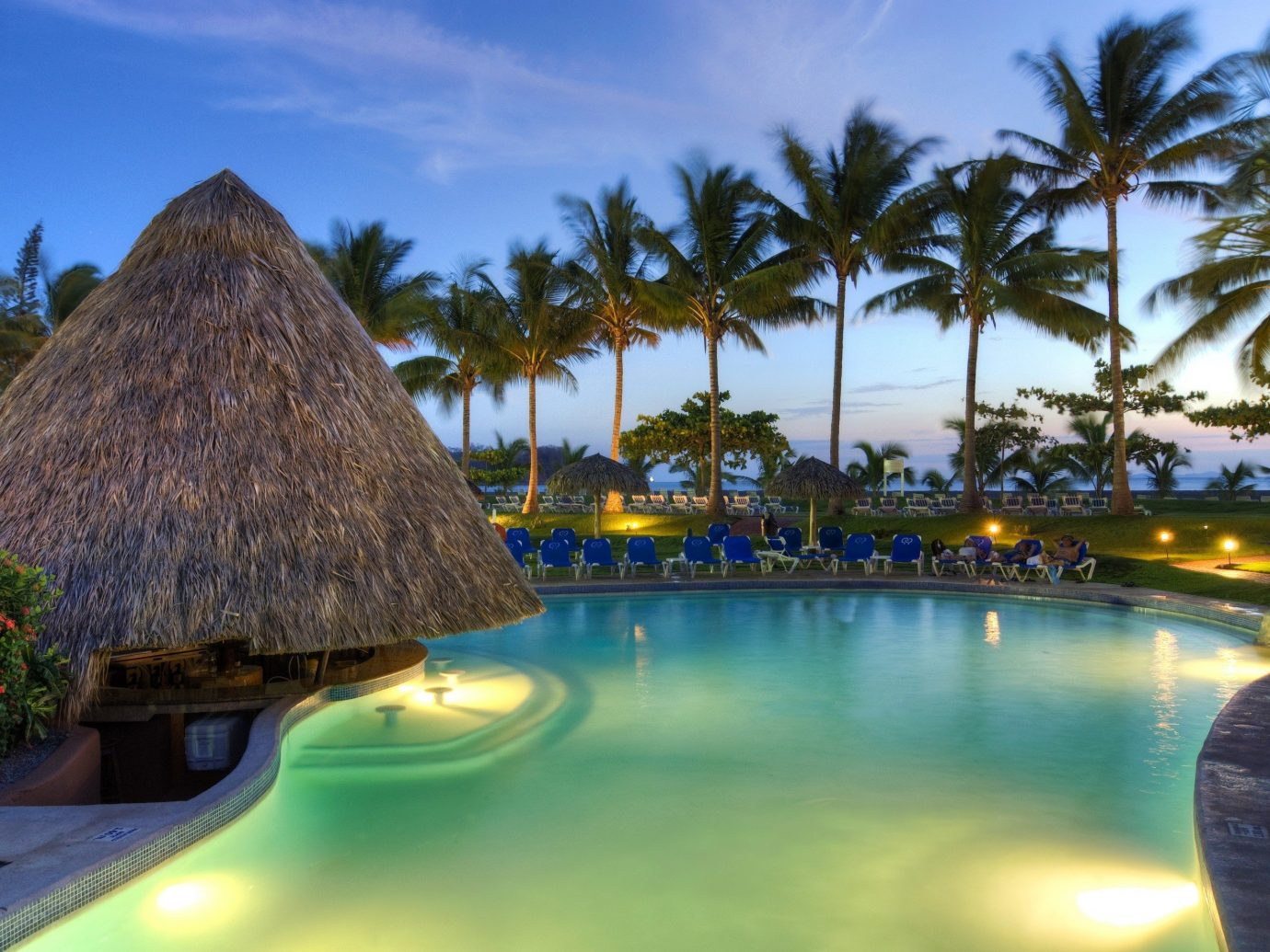 Hotels sky tree outdoor swimming pool Resort vacation estate arecales palm Sea tropics Lagoon caribbean bay surrounded