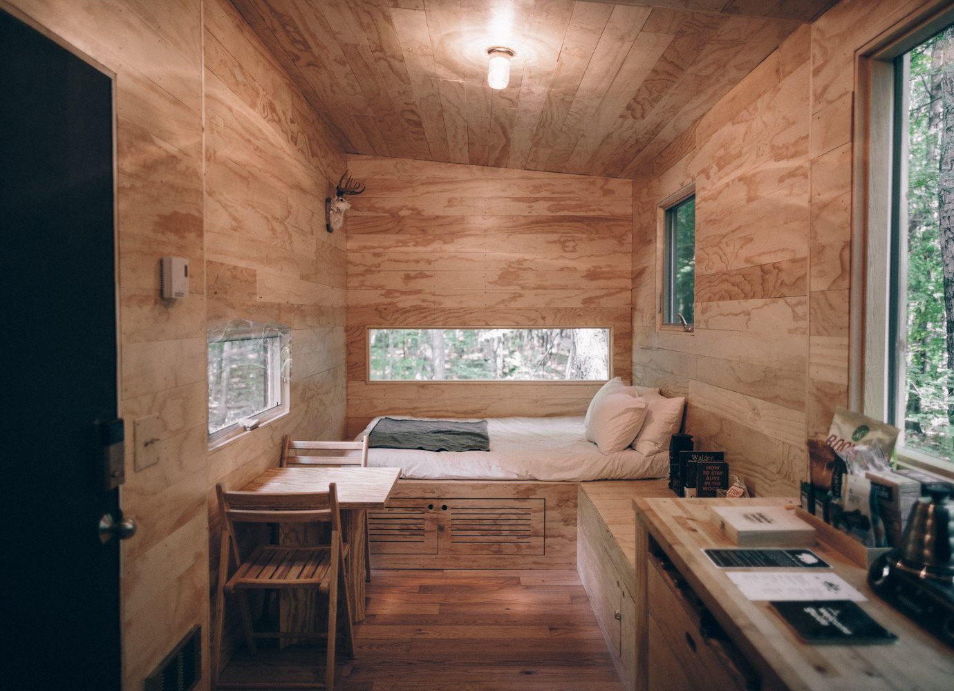 Boutique Hotels Fall Travel Hotels Outdoors + Adventure indoor floor window room Living Architecture ceiling wall interior design wood wooden home house real estate daylighting log cabin living room table hardwood flooring estate furniture stone