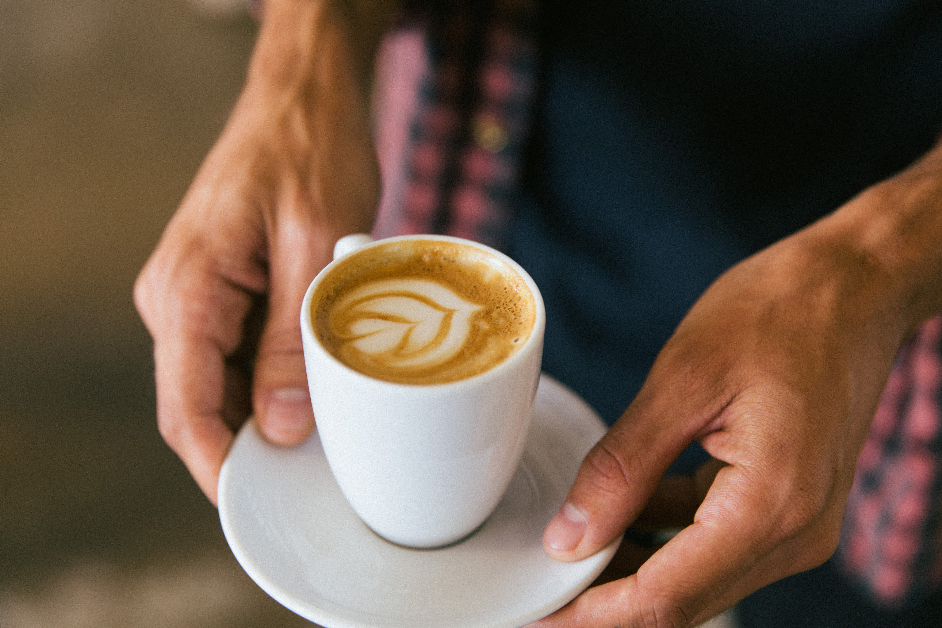 Jetsetter Guides cup coffee person Drink beverage indoor food latte caffeine espresso sense flavor breakfast coffee cup