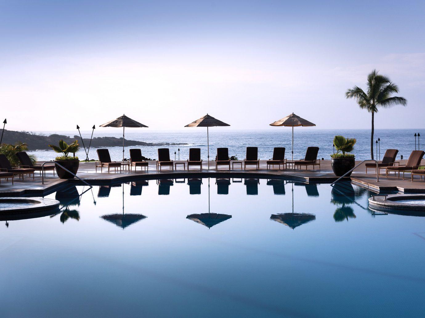 Beachfront Hotels Living Lounge Luxury Pool Romance Trip Ideas sky outdoor reflection marina water dock Resort vacation estate Sea swimming pool bay dusk Lake day