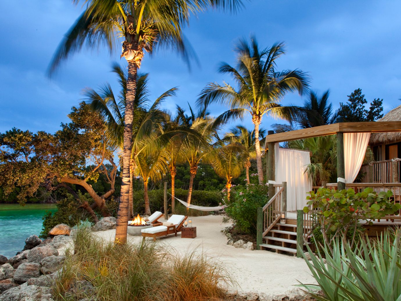 Beach Beachfront Hotels Island Outdoors Resort Romance Romantic Trip Ideas Waterfront tree outdoor sky palm property estate vacation arecales Garden home real estate palm family Villa plant shore surrounded