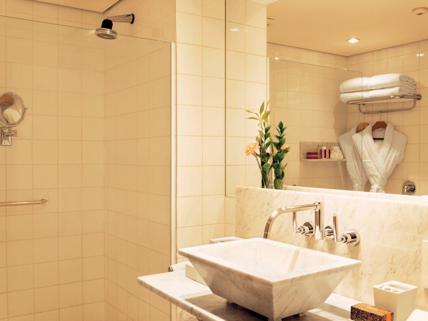 Hotels wall indoor bathroom room tile interior design floor plumbing fixture flooring sink vessel product design ceiling tap ceramic interior designer toilet public water basin tiled