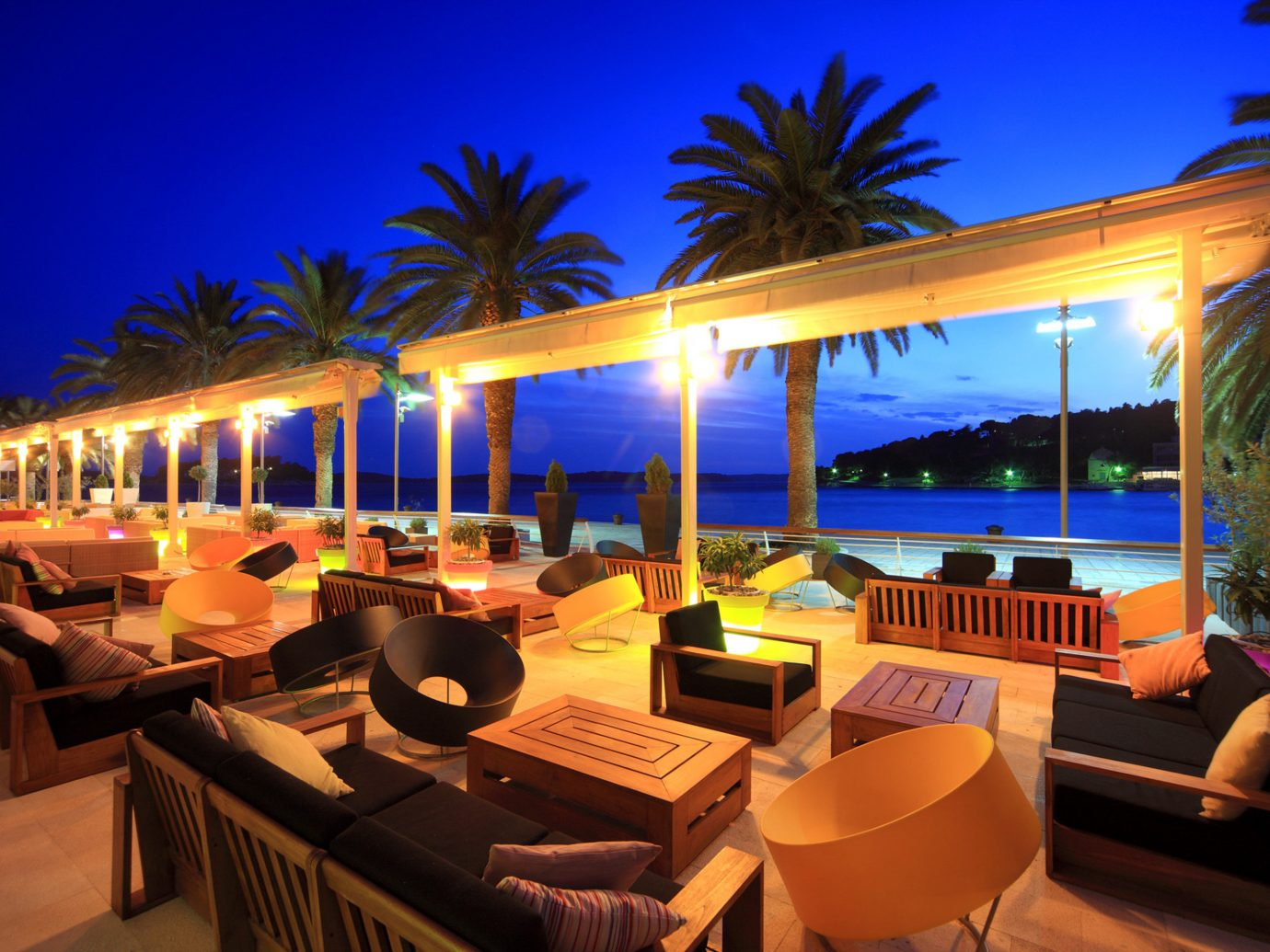 Drink Lounge Nightlife Pool Scenic views Trip Ideas Tropical Resort restaurant vacation estate Villa night