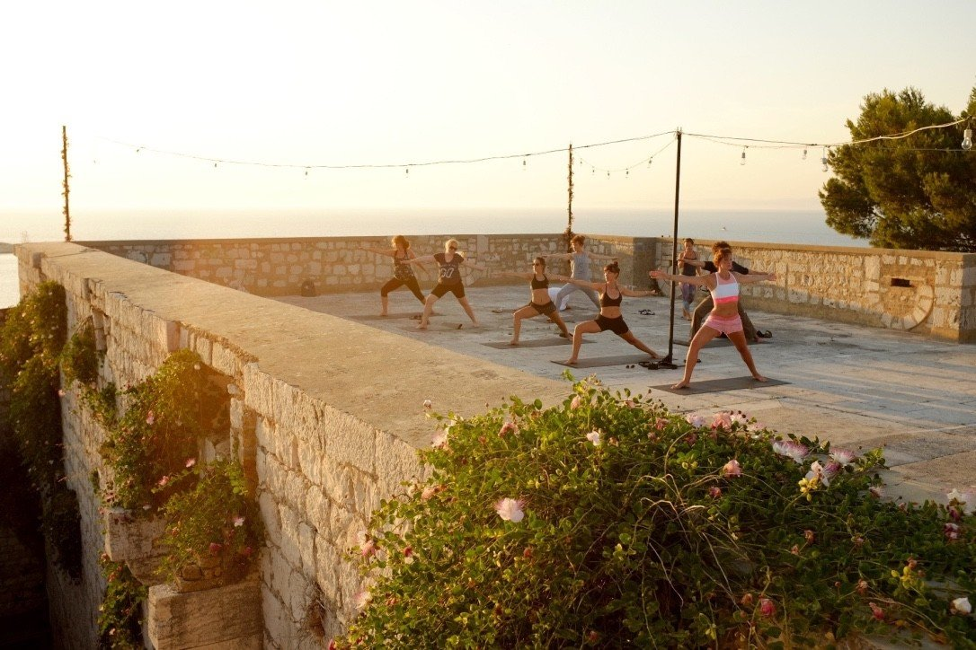 activities airy calm class exercise glow Health + Wellness isolation meditation Meditation Retreats Ocean ocean view orange orange sky Outdoor Activities overlook Patio people relaxation relaxing remote Rooftop Scenic views serene Spa Retreats Sunset Terrace Trip Ideas view yoga Yoga Retreats sky outdoor wall walkway