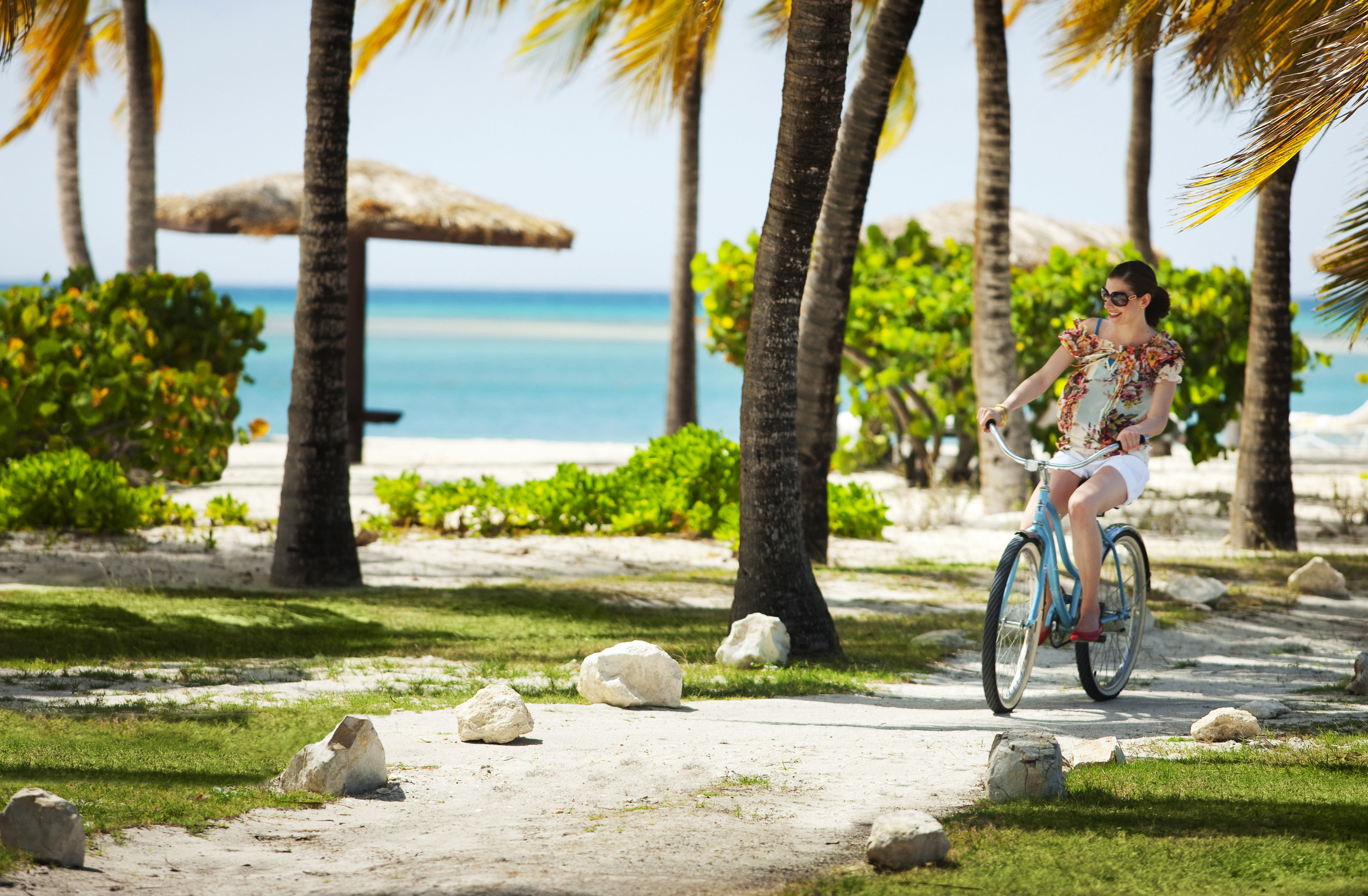 All-inclusive Beach Beachfront Hotels Island Luxury Outdoor Activities Outdoors Trip Ideas Waterfront Wellness grass outdoor tree bicycle vacation estate Resort plant