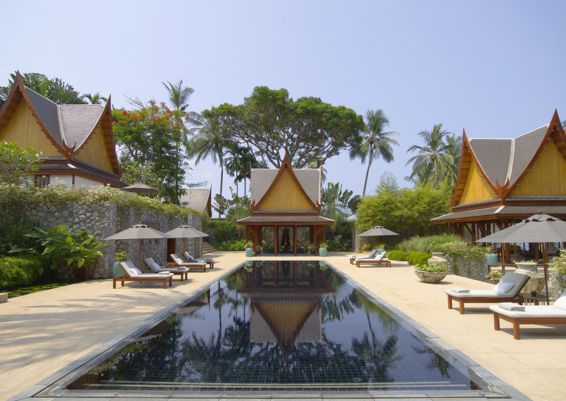 Beach Hotels Phuket Thailand tree outdoor sky property building Resort estate Villa vacation swimming pool temple wat outdoor structure palace hacienda mansion several