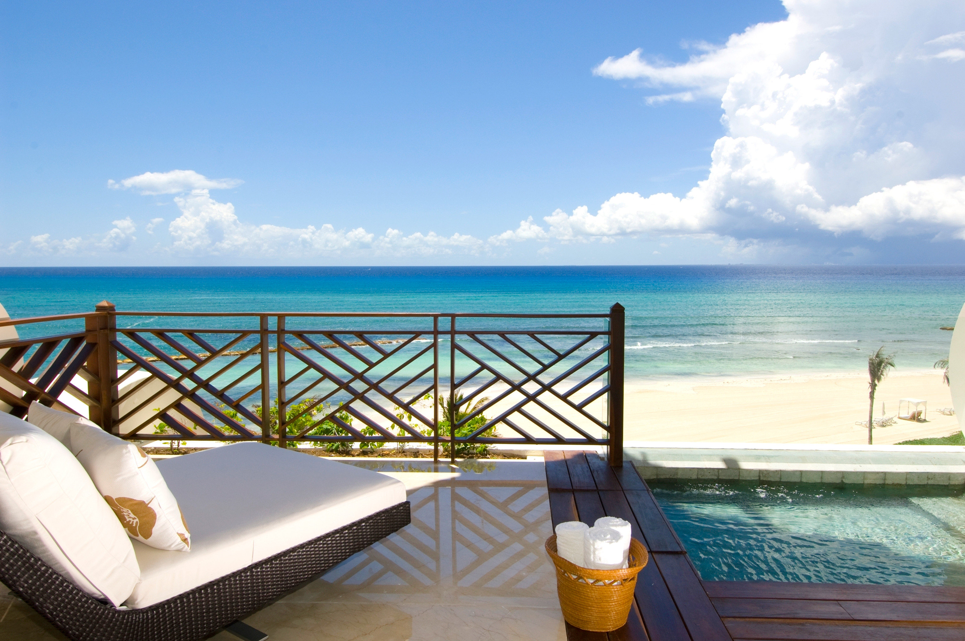 All-Inclusive Resorts Beachfront Elegant Hotels Living Lounge Luxury Modern Romance Scenic views Tropical sky water outdoor property leisure caribbean swimming pool vacation Resort Ocean Sea Beach Villa estate overlooking bay shore day