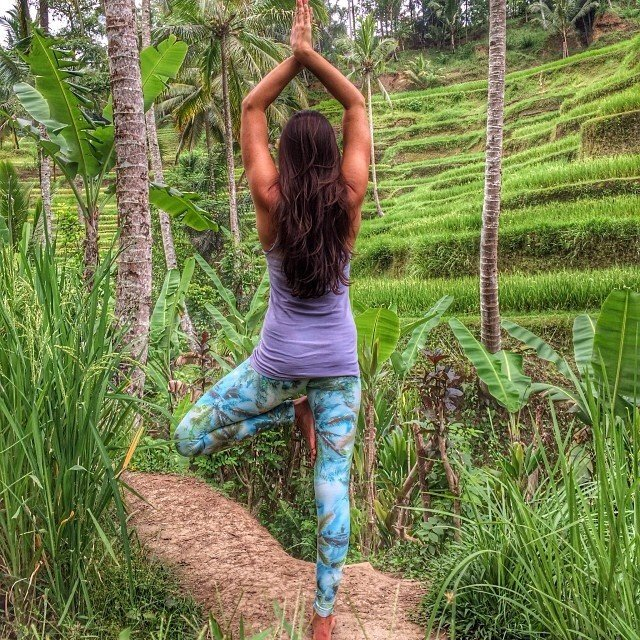 Health + Wellness Meditation Retreats Trip Ideas Yoga Retreats grass outdoor green human positions tree lawn plant sports grass family physical fitness meadow flower agriculture