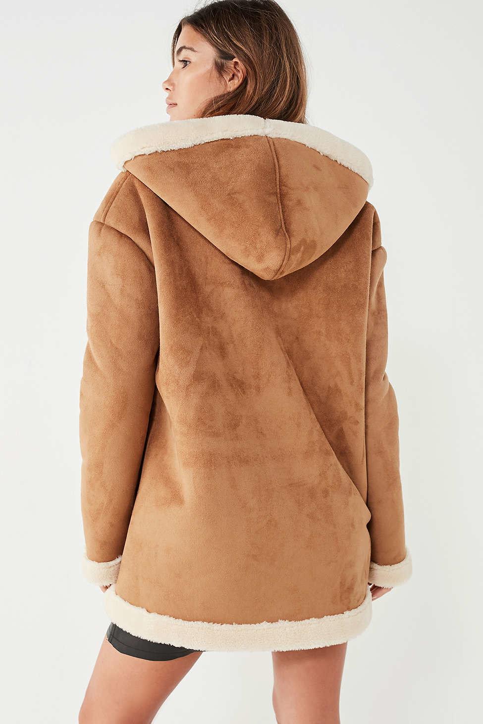 Style + Design Travel Shop person fur clothing fur hood wearing coat old beige jacket overcoat fashion model peach sleeve posing tan