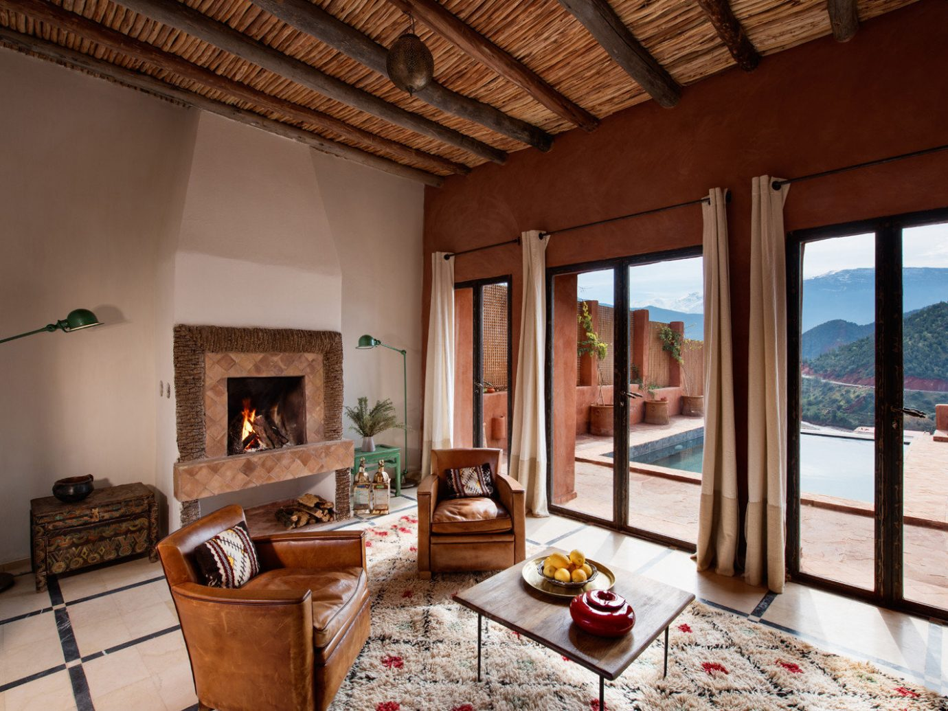 Arts + Culture Marrakech Morocco Style + Design indoor Living floor room property ceiling living room Fireplace estate interior design real estate hacienda Villa window furniture