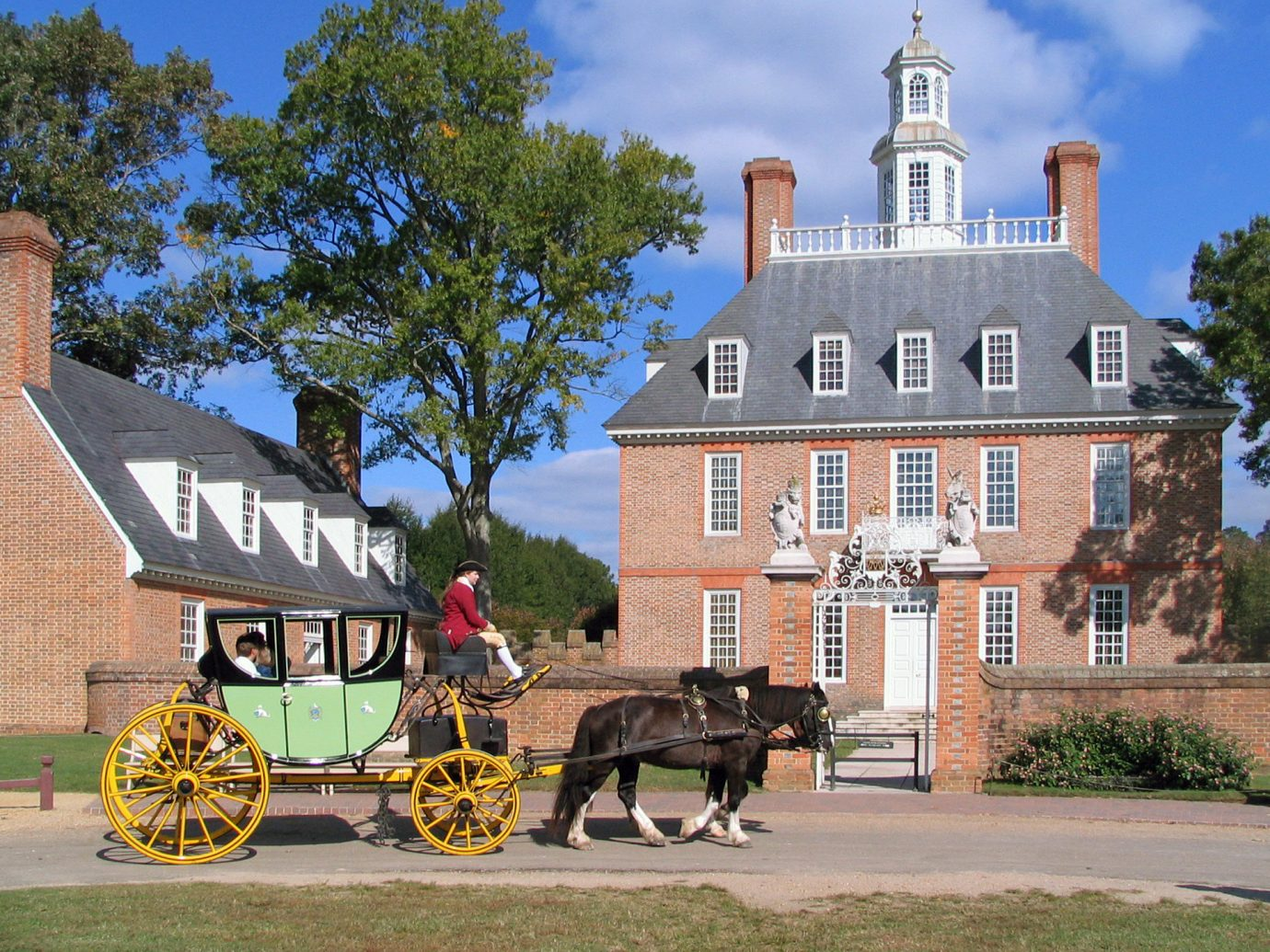 Trip Ideas outdoor tree building road carriage Town landmark street drawn house estate vacation tourism pulling home château place of worship Church horse-drawn vehicle cart