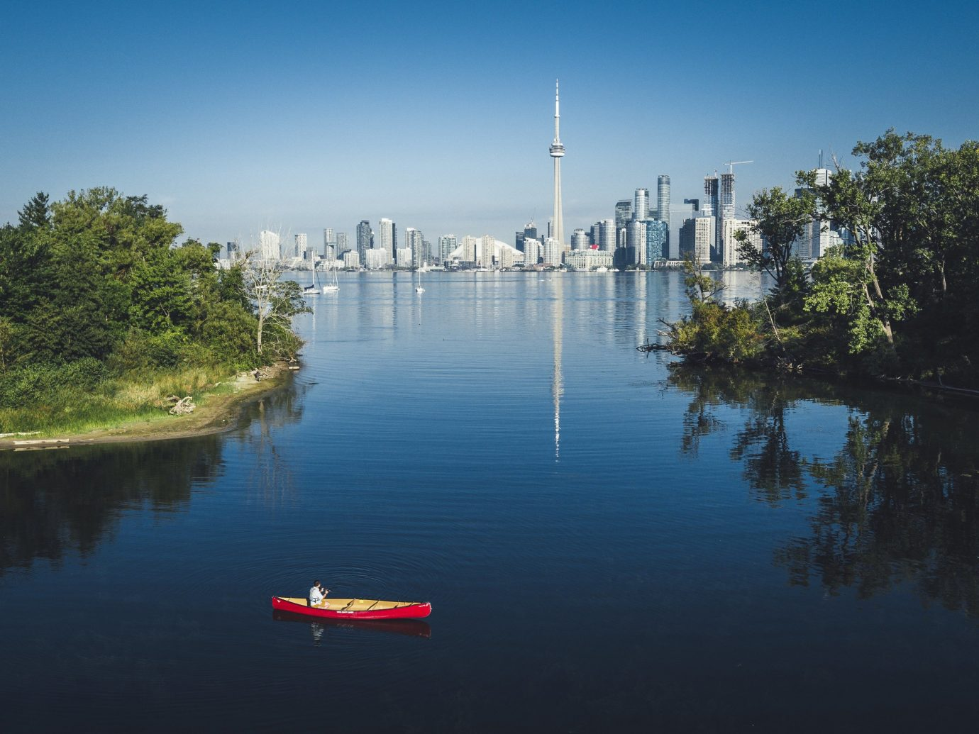Canada Montreal Toronto Trip Ideas water outdoor sky tree reflection Boat atmospheric phenomenon Lake River morning reservoir Sea vehicle dusk traveling surrounded day