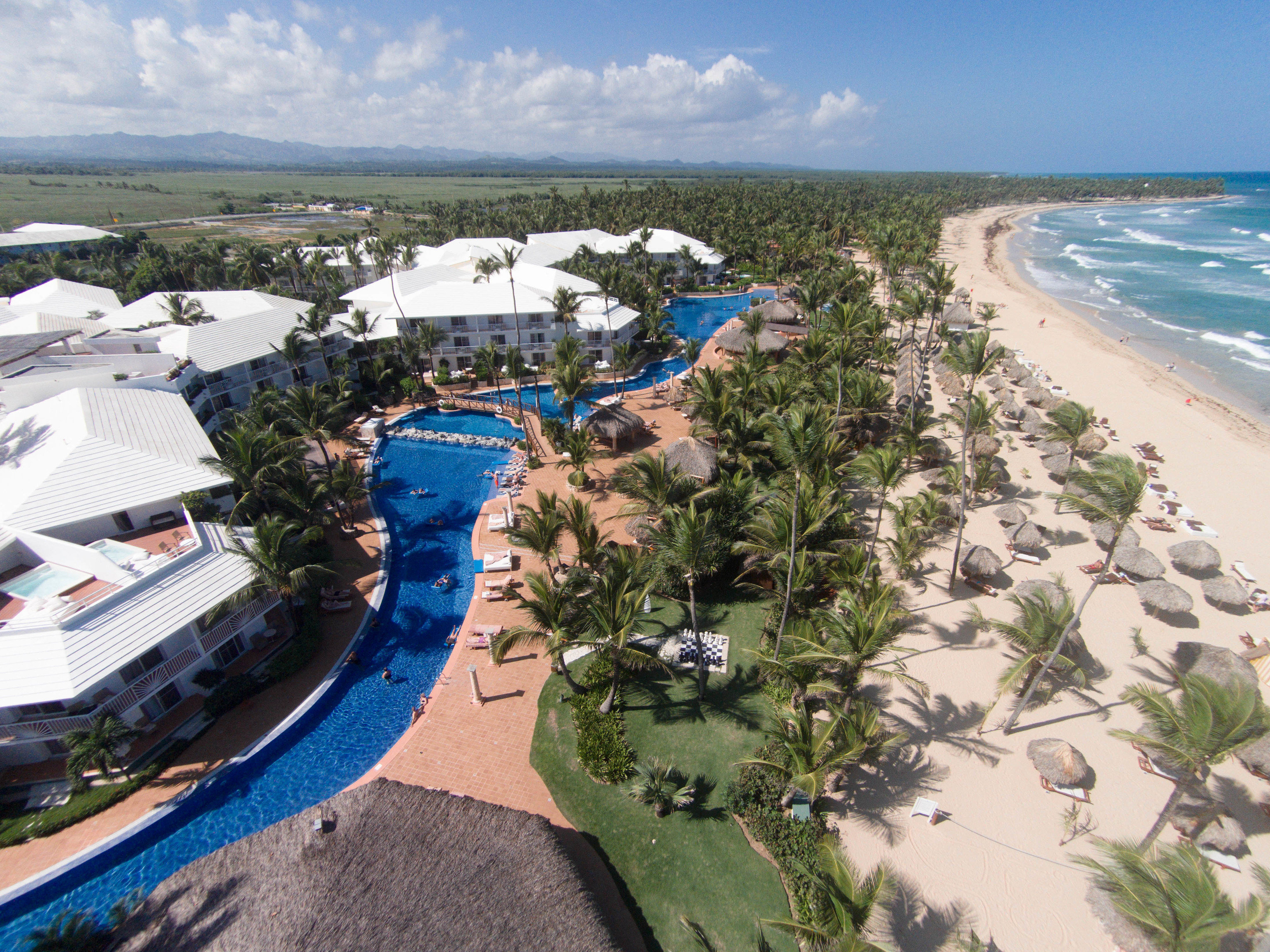 All-Inclusive Resorts Hotels Romance sky outdoor water Nature aerial photography Resort Coast marina bird's eye view Water park vacation Beach shore residential area bay cape Sea dock park reef