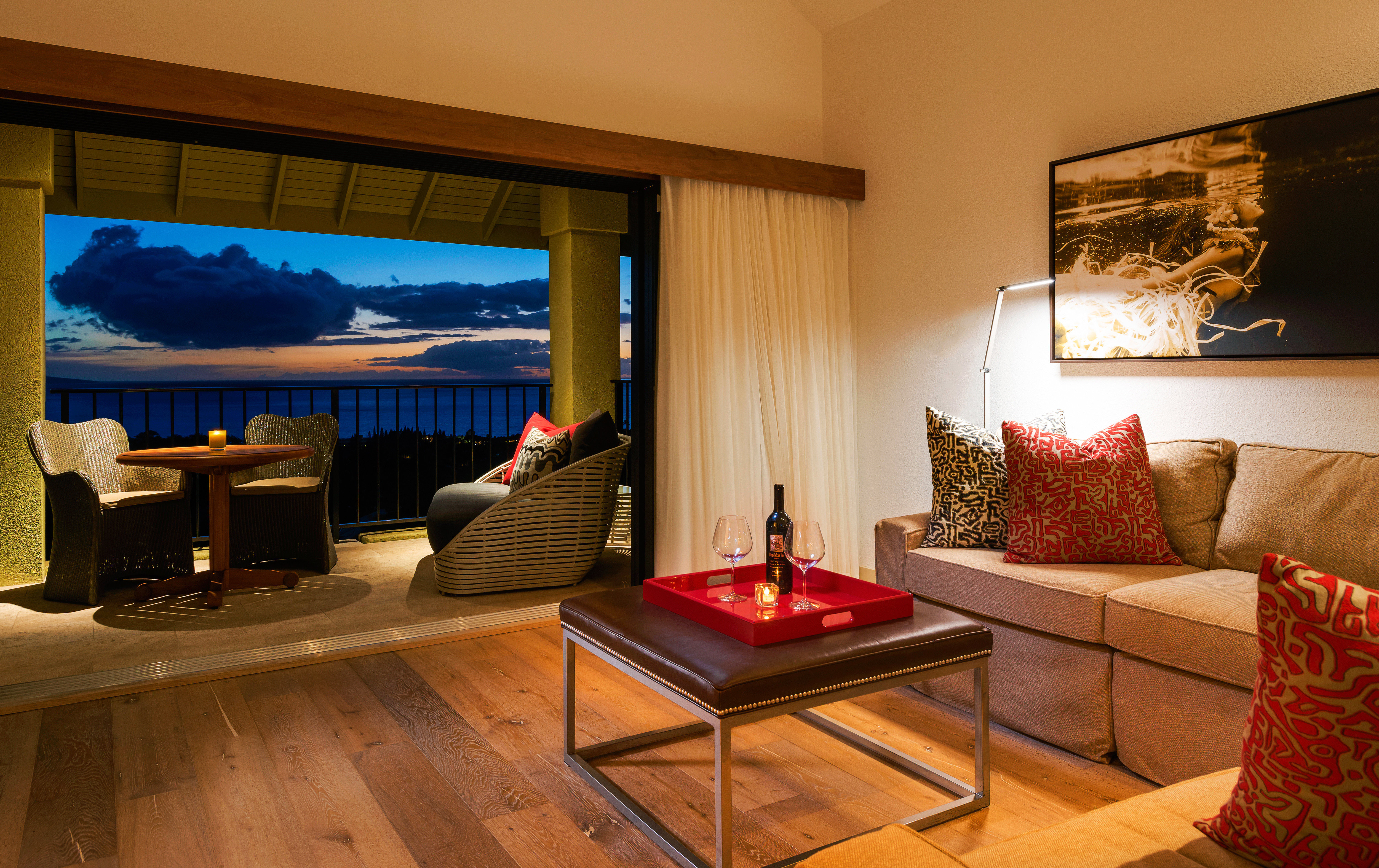 Balcony Classic Drink Hotels Island Living Romance Scenic views Sunset indoor wall floor room property living room Suite estate interior design home Villa real estate Resort Design condominium cottage apartment furniture flat