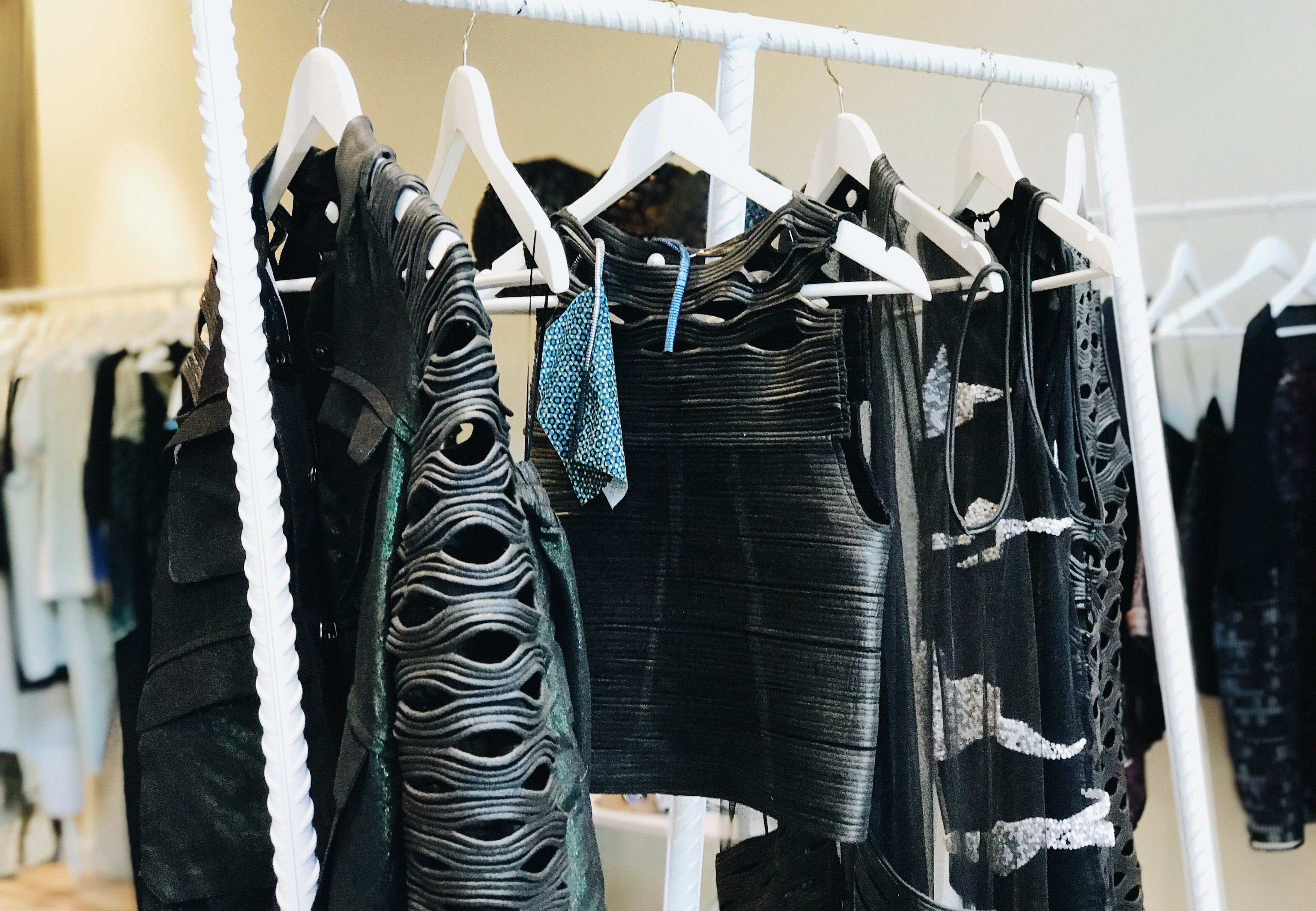 Trip Ideas indoor black clothing room footwear Boutique fashion rack textile leather