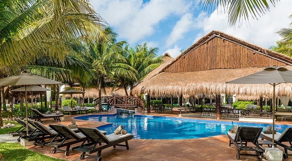 All-Inclusive Resorts Hotels Romance outdoor tree chair umbrella Resort lawn property swimming pool leisure building Pool estate real estate wooden vacation palm tree hacienda arecales Villa resort town eco hotel hotel cottage tourism blue area palm furniture lined Deck several swimming