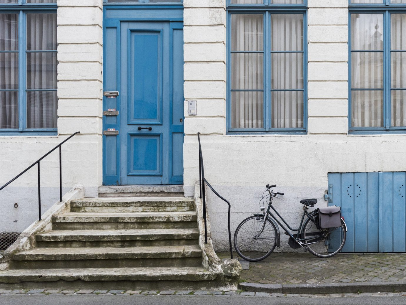 Trip Ideas building outdoor bicycle blue road house urban area wall sidewalk street Architecture home facade window wood infrastructure parked door cottage cement stone concrete