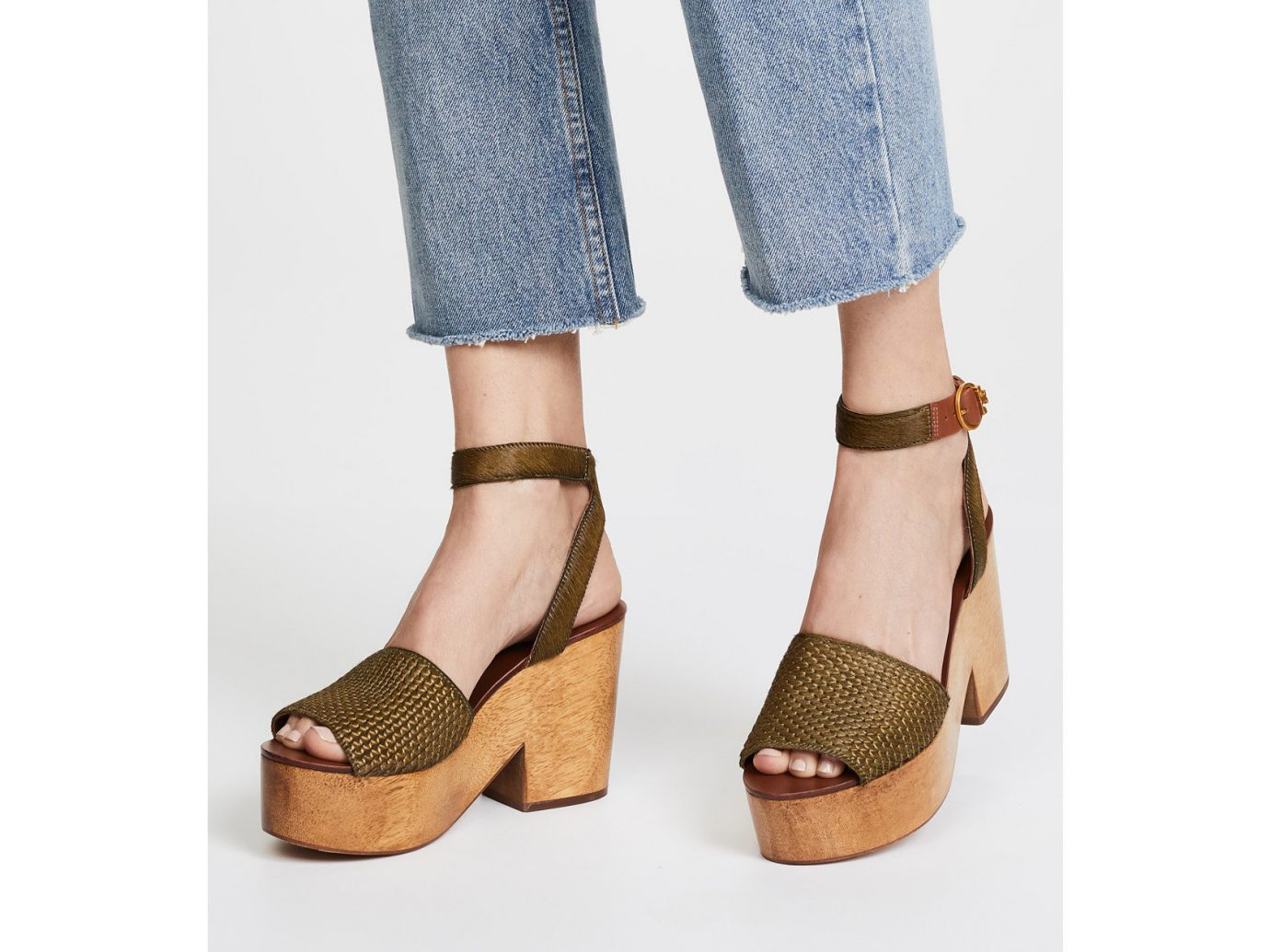 Spring Travel Style + Design Travel Shop person footwear clothing shoe wearing high heeled footwear sandal outdoor shoe shoes suit human leg ankle coat feet posing dressed tan