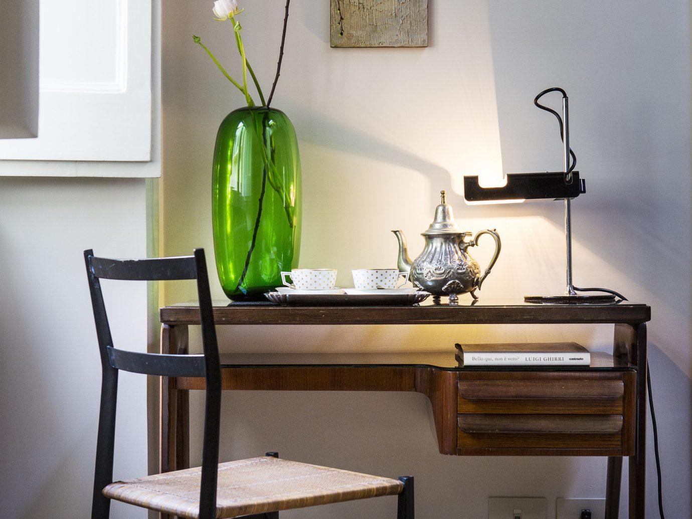 Hotels wall floor indoor furniture dining room room table desk living room interior design wood home lamp