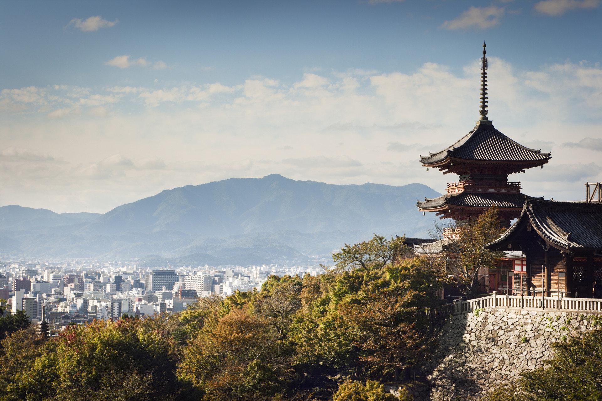Arts + Culture Festivals + Events Travel Tips outdoor sky landmark mountain tourism place of worship mountain range castle tower château temple