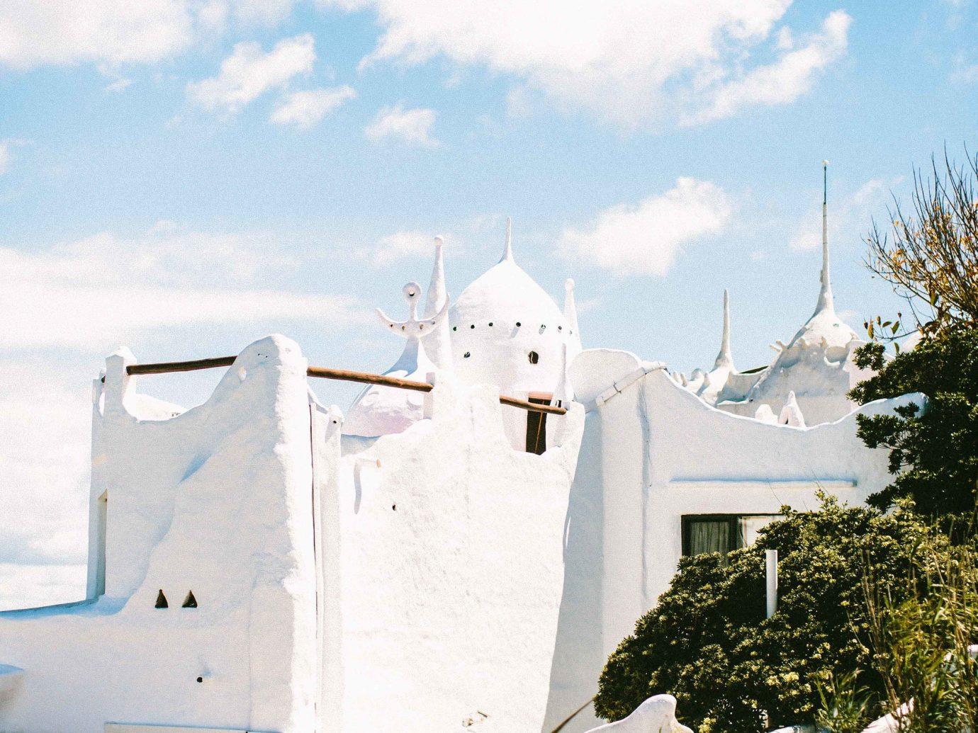 Beach Romantic Getaways south america Trip Ideas Uruguay sky Architecture tree cloud building facade roof tourism