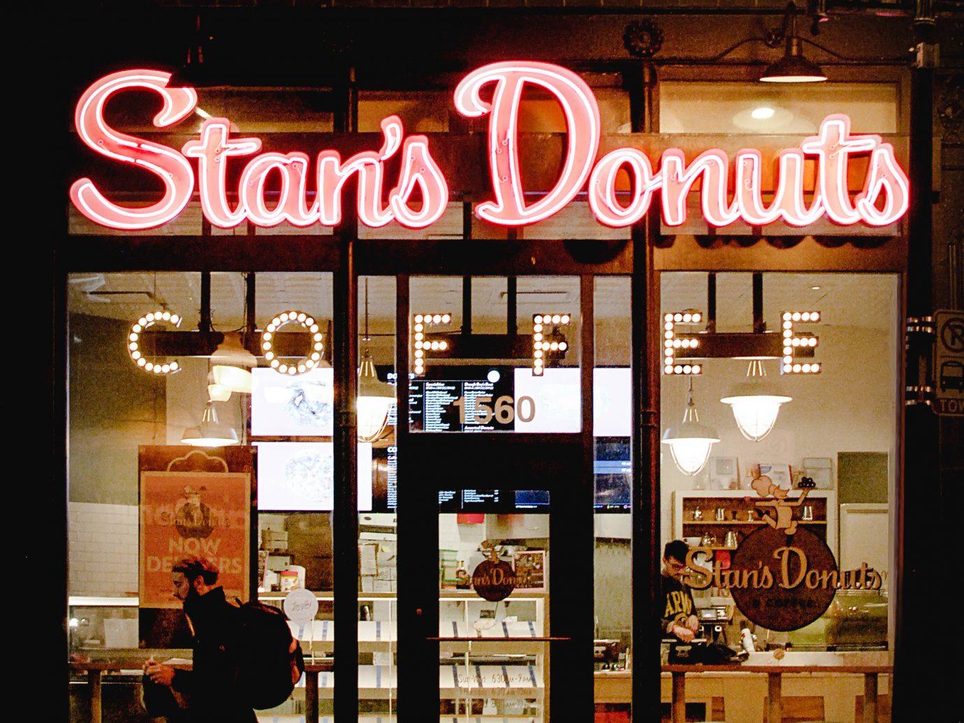 Arts + Culture Food + Drink Hotels Weekend Getaways outdoor sign night display window window City neon street facade Shop store restaurant
