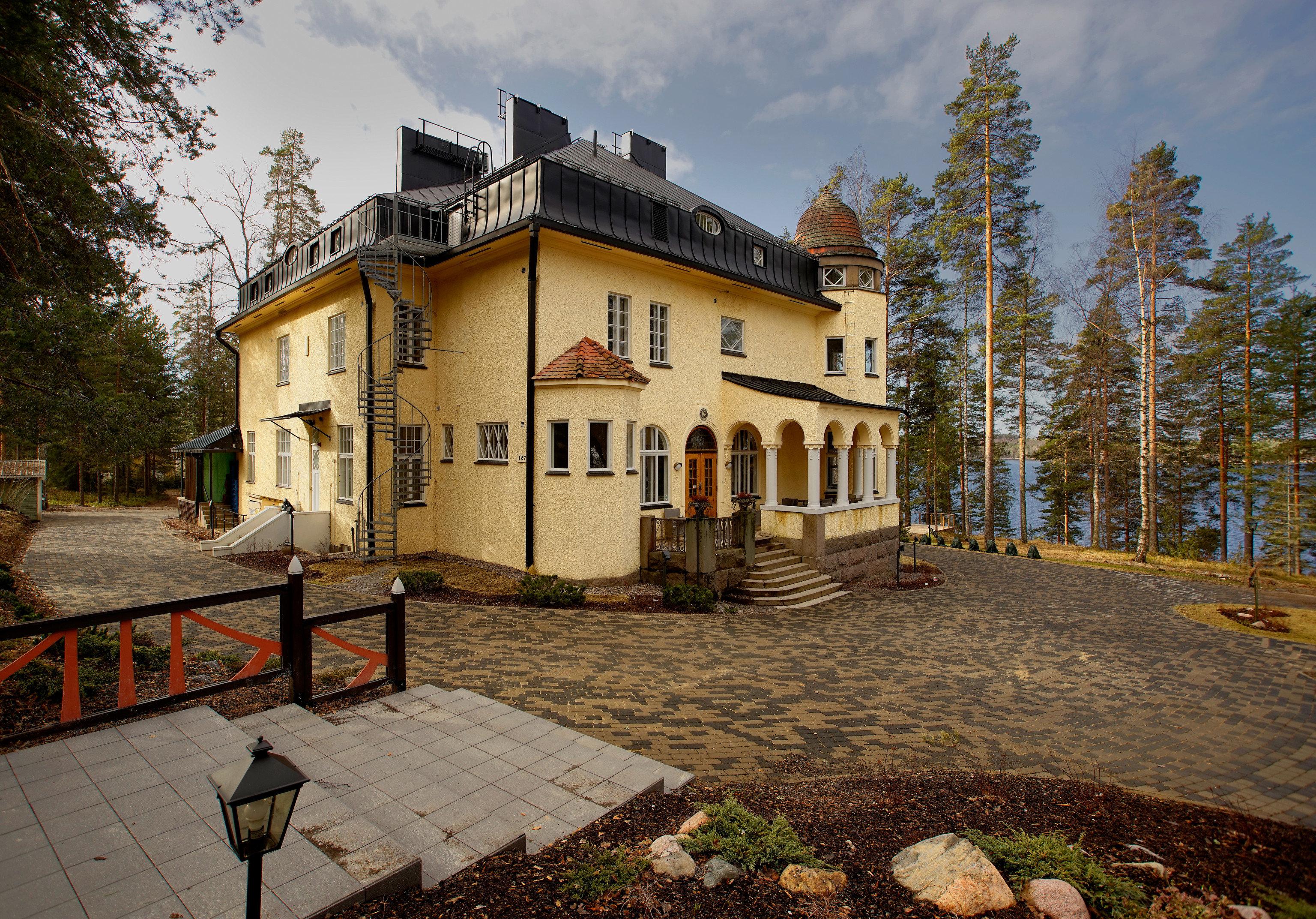 Denmark Finland Hotels Landmarks Luxury Travel Sweden outdoor tree ground property home estate house real estate cottage Villa building sky mansion facade window farmhouse stone walkway