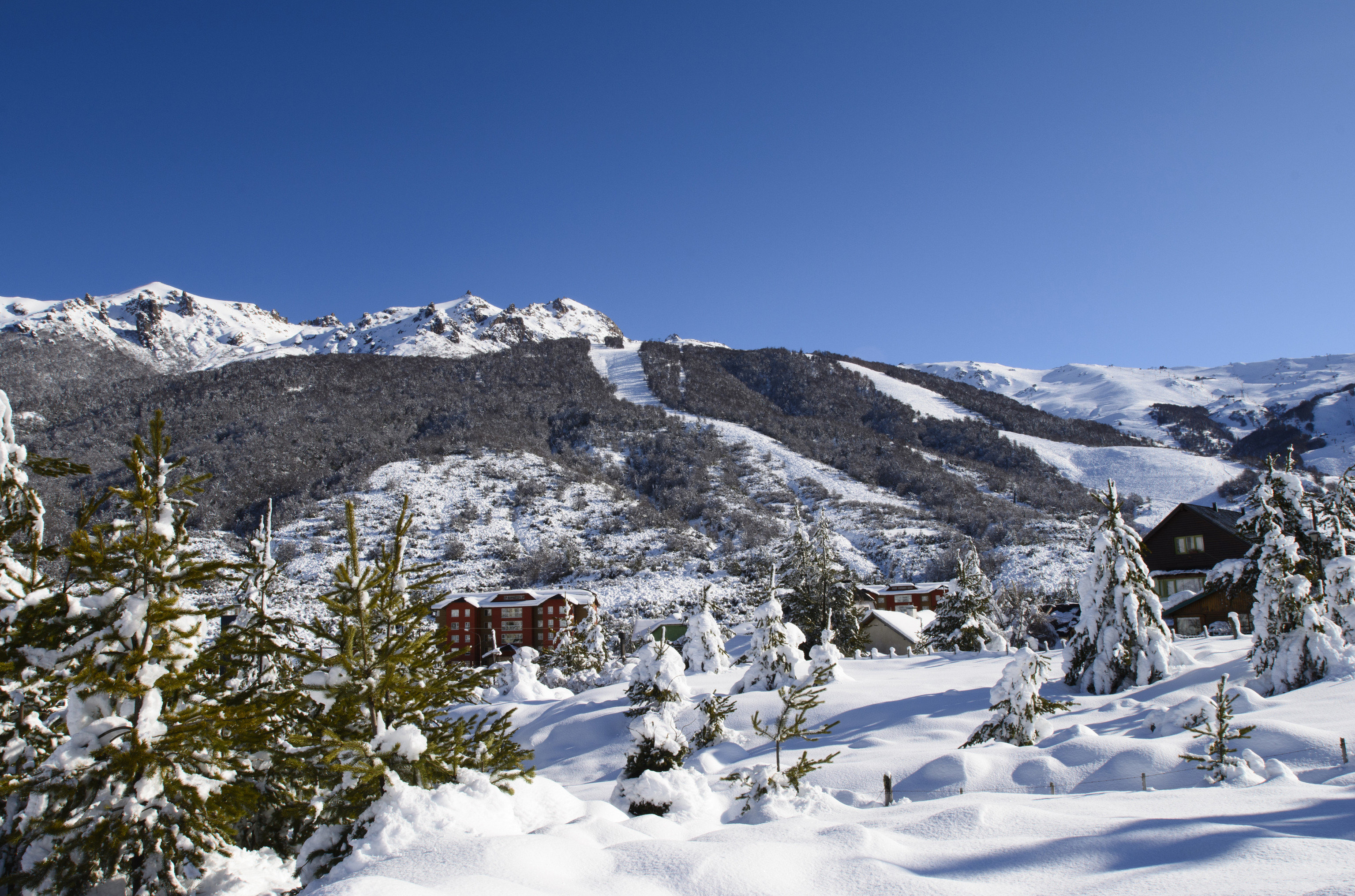 Outdoors + Adventure snow outdoor sky skiing Winter mountain mountainous landforms mountain range Nature wilderness tree ridge freezing massif alps geological phenomenon mount scenery slope cloud landscape hill summit mountain pass glacial landform fell pine family fir conifer elevation ice valley cirque national park
