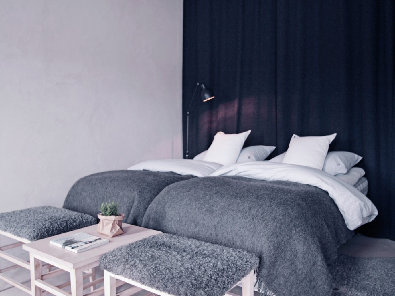 Design Hotels indoor wall room floor bed frame Bedroom furniture bed interior design home curtain house window Suite wood mattress daylighting ceiling couch window covering window treatment table comfort bed sheet apartment