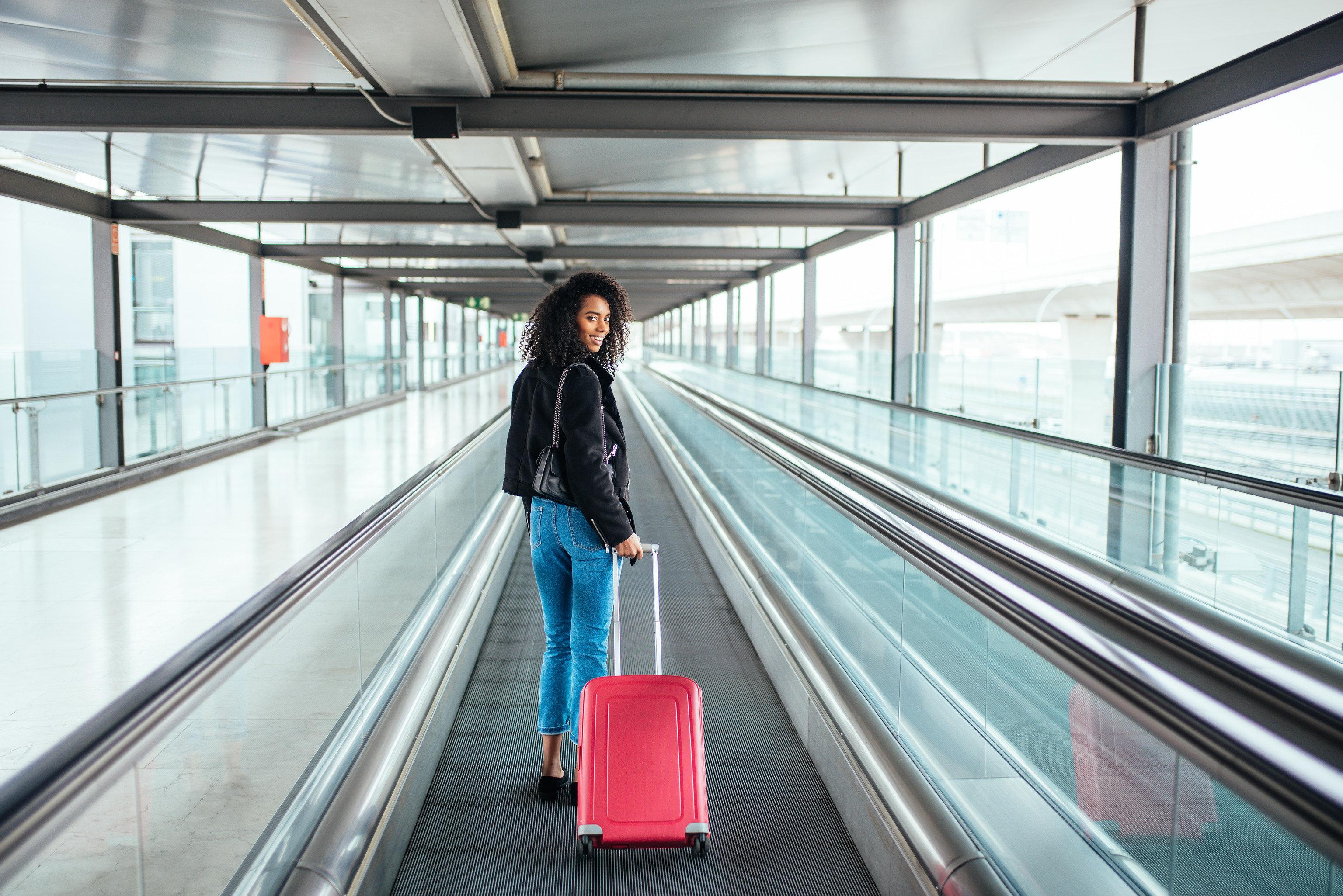 Travel Shop escalator indoor luggage ceiling platform infrastructure airport train public transport building subway pulling