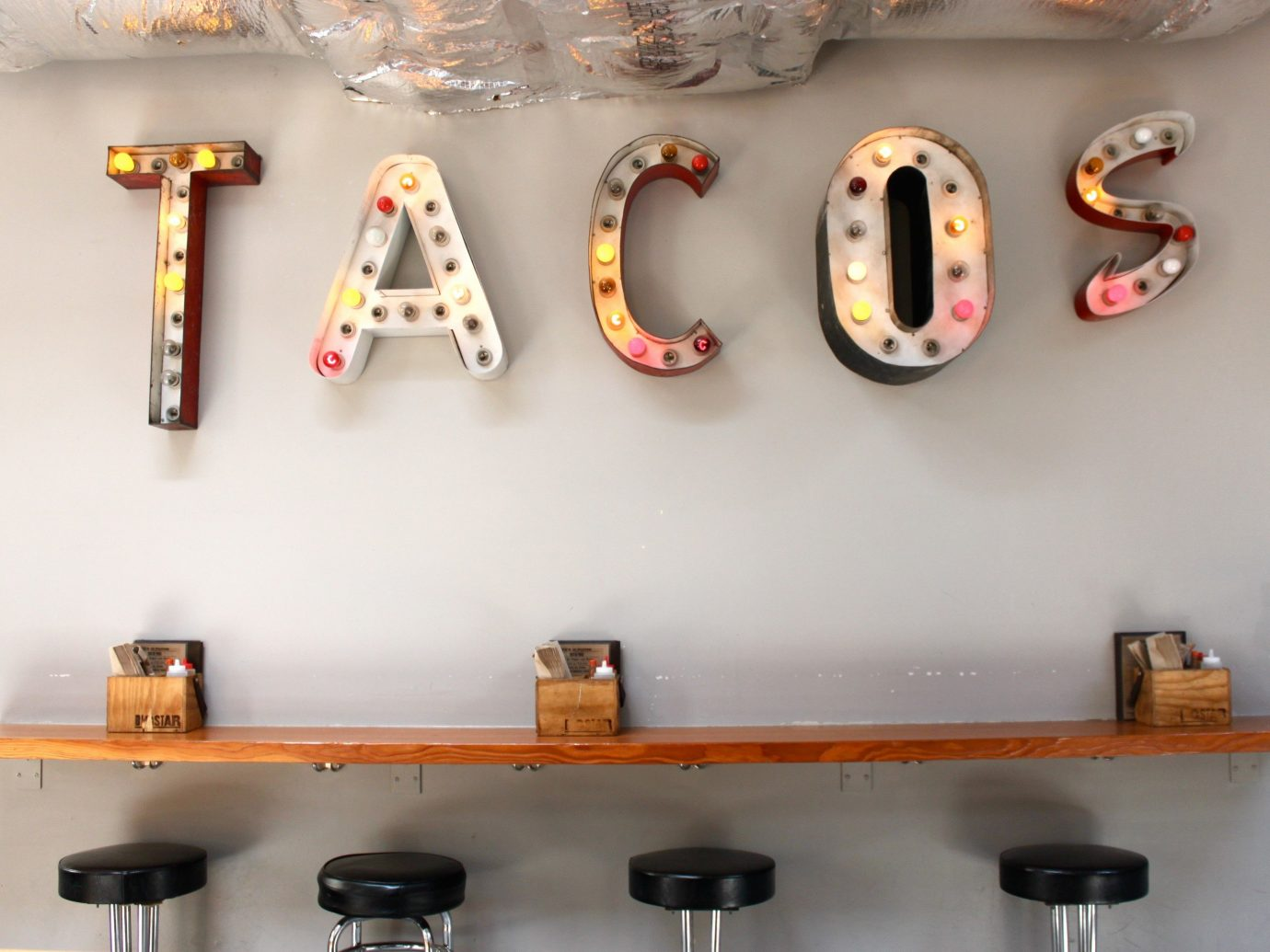 Food + Drink wall indoor font shelf product different counter guitar various several colored